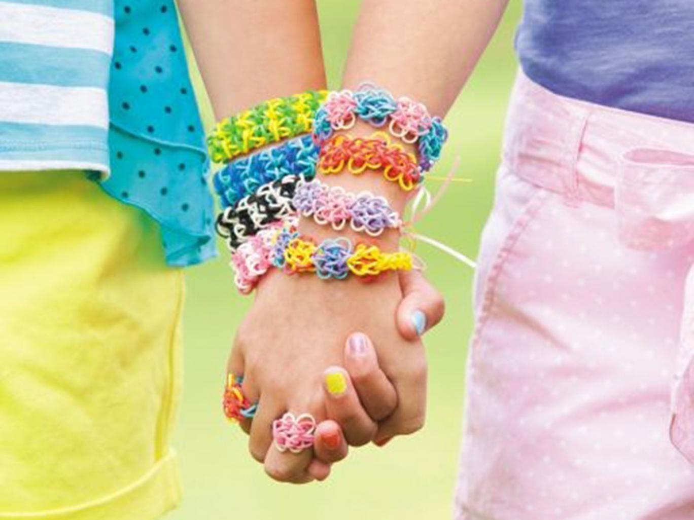 The Rainbow Loom weaves elastics into bracelets