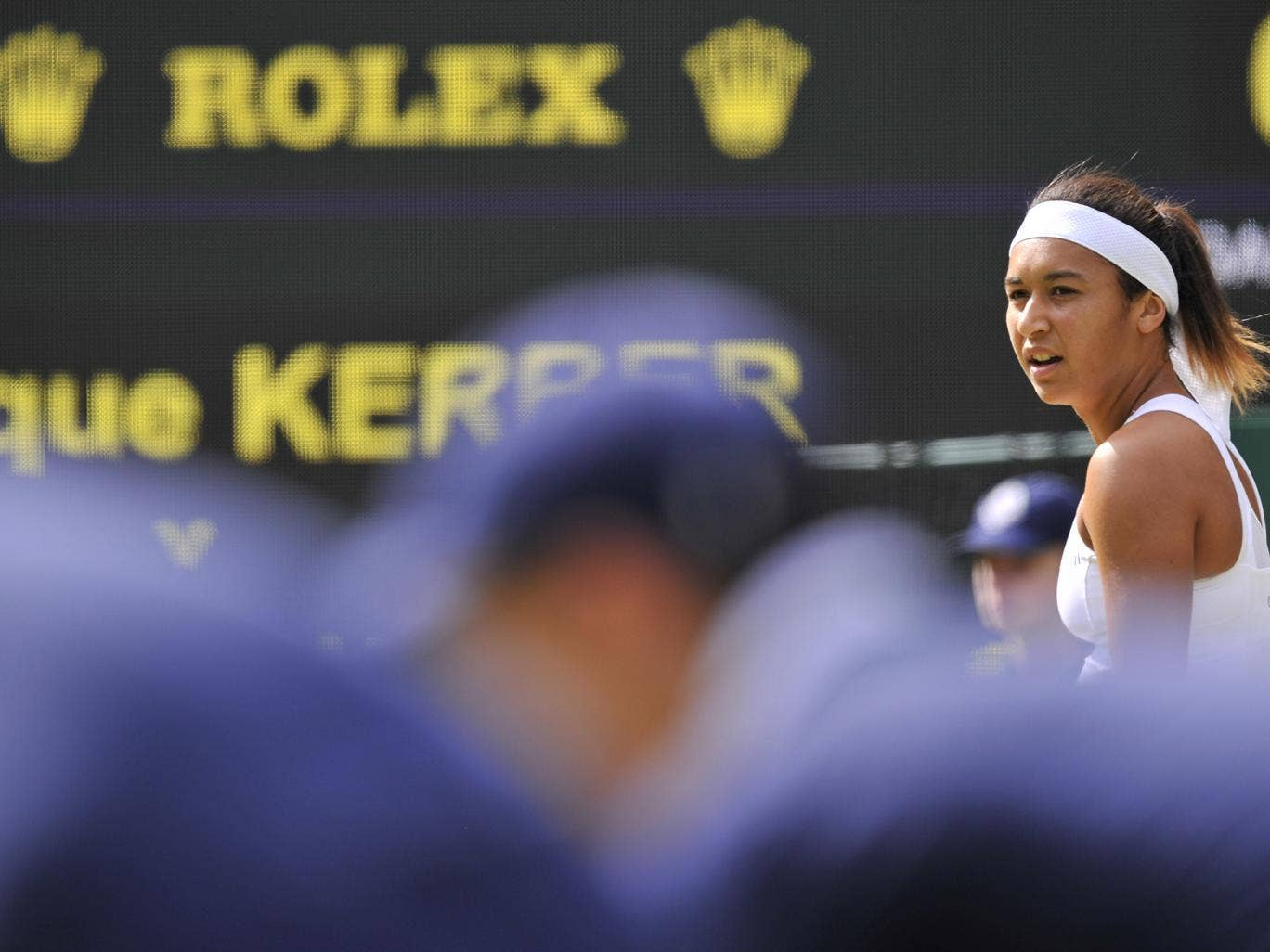 Britain's Heather Watson (R) looks on during her women's singles second round defeat to Germany's Angelique Kerber