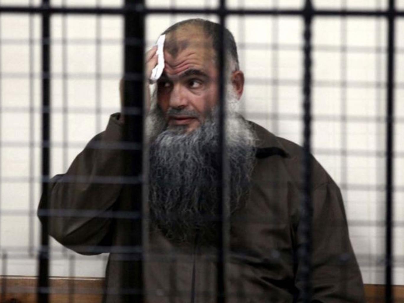 Abu Qatada behind bars in court. The radical Islamist preacher will not be allowed to return to Britain.