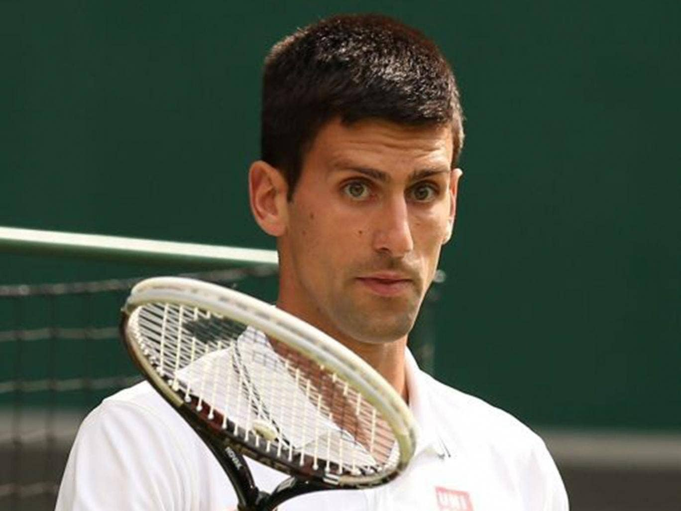 Protection racket: When Djokovic steps out in front of the crowd he is stony-faced