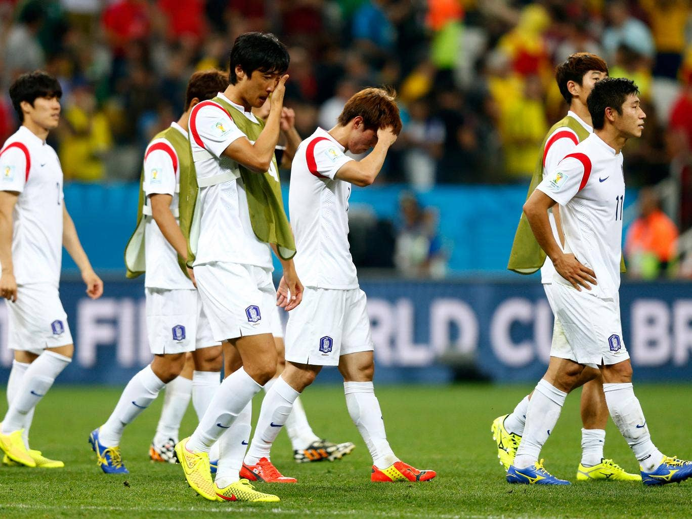 South Korea players look dejected after a 0-1 defeat to Belgium in the 2014 FIFA World Cup