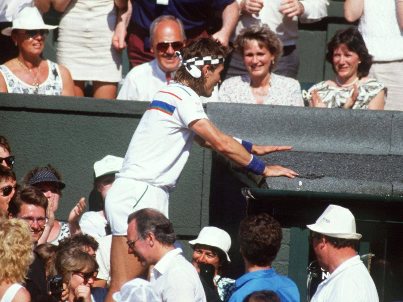 Pat Cash clambered into the crowd following his win against  Ivan Lendl at Wimbledon in 1987