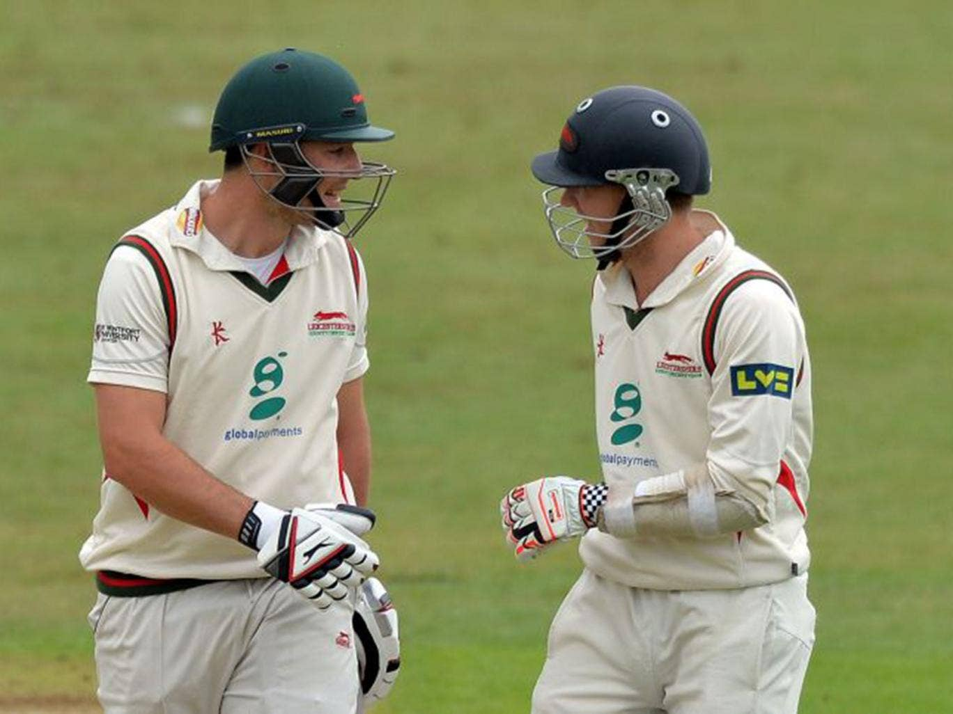 Double delight: Leicestershire's Greg Smith, left, and Angus Robson chat on the way to a century apiece