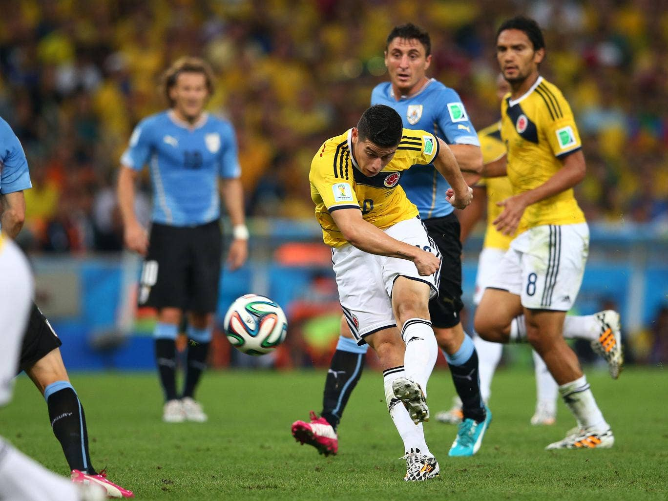 James Rodriguez scores during Colombia's 2-0 win over Uruguay