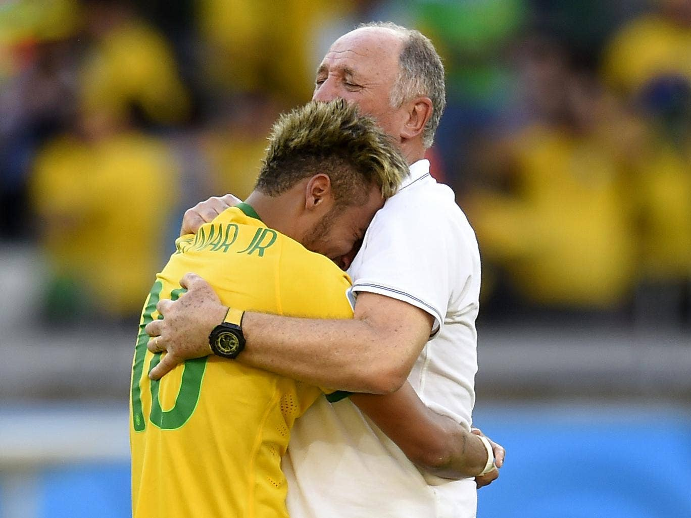 Neymar and Scolari embrace after Brazil went through on penalties against Chile