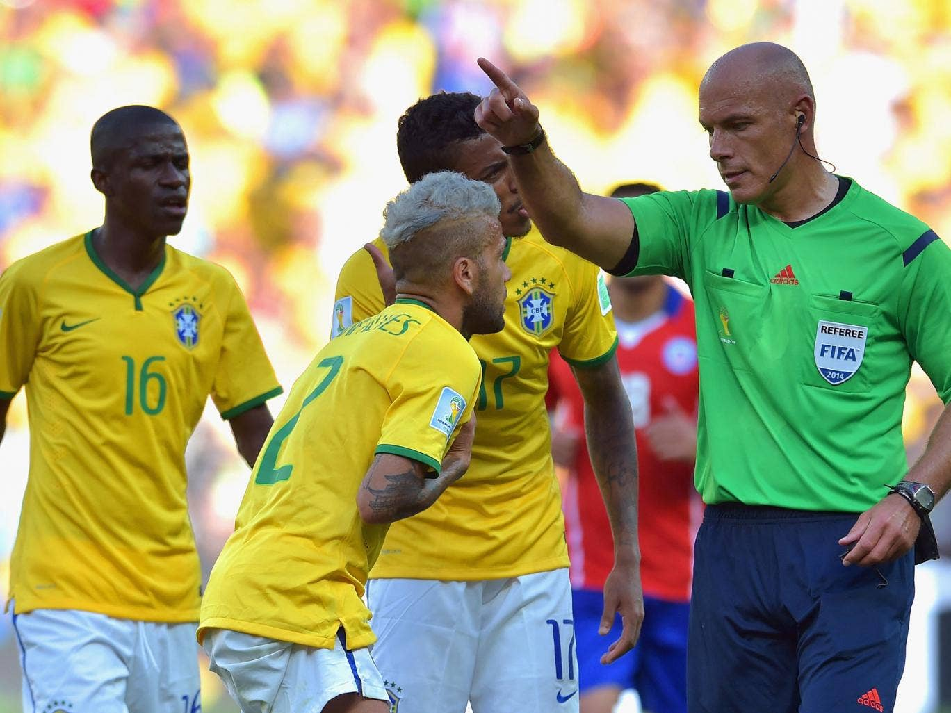 Brazil's Danny Alves remonstrates with the referee Howard Webb during Saturday's match