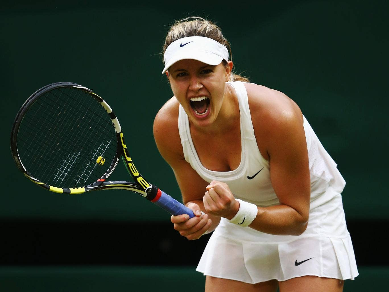 Eugenie Bouchard of Canada celebrates after winning her Ladies' Singles fourth round match against Alize Cornet