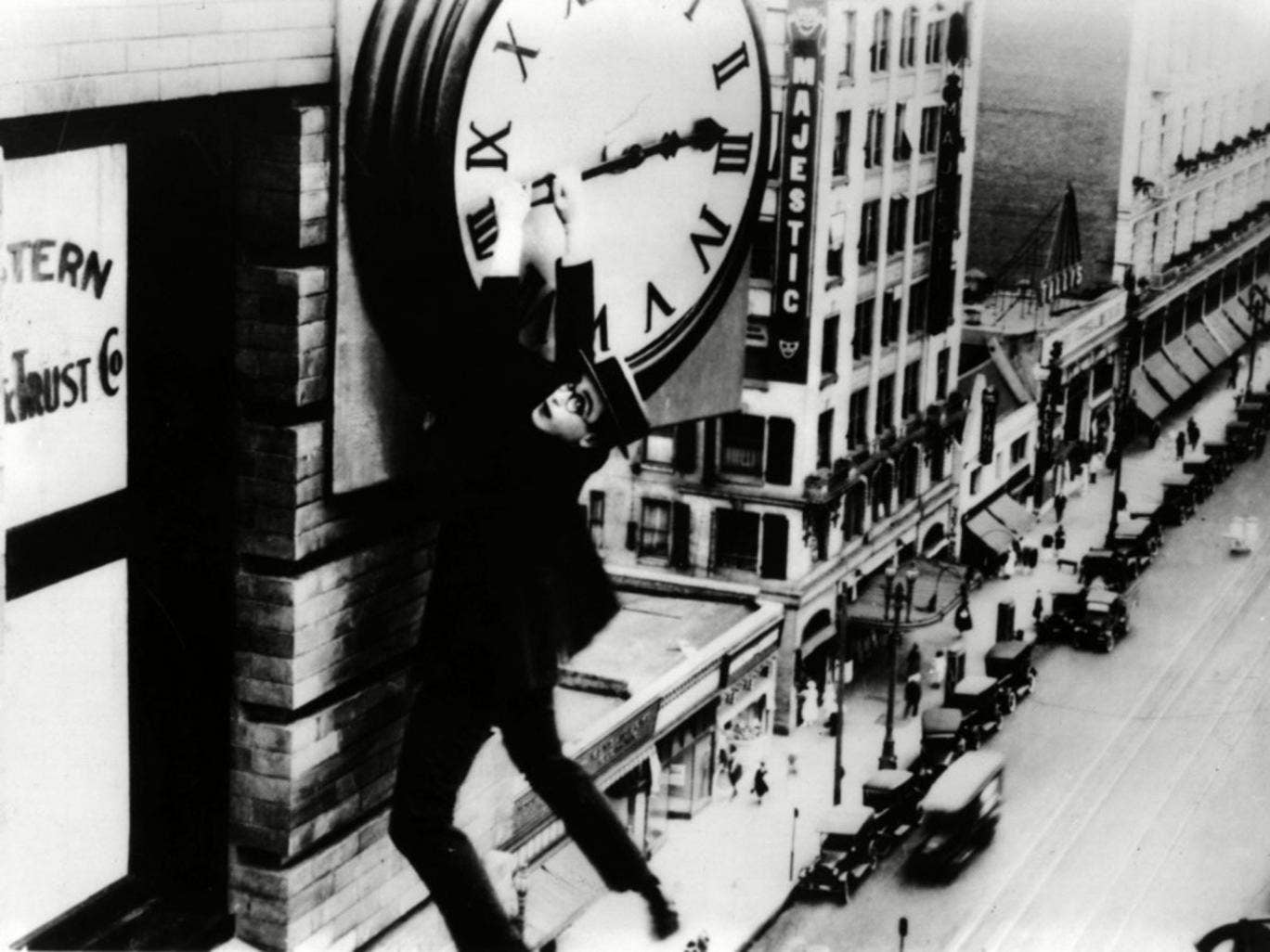 Time on his hands: silent comedian Harold Lloyd grasps the hands of a skyscraper's clock in his film 'Safety Last' from 1923