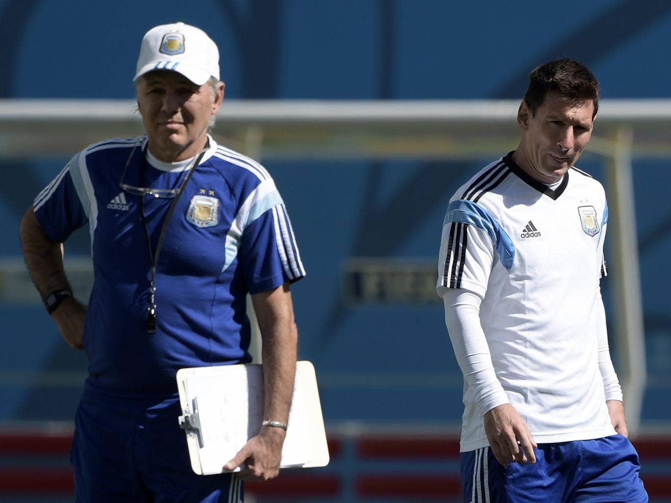 Argentina's forward Lionel Messi (R) is watched by coach Alejandro Sabella