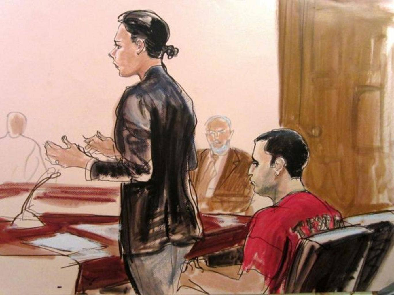 In this 25 October, 2012, file courtroom drawing, federal defender Julia Gatto requests bail for her client, New York City police Officer Gilberto Valle, right, at Manhattan Federal Court in New York