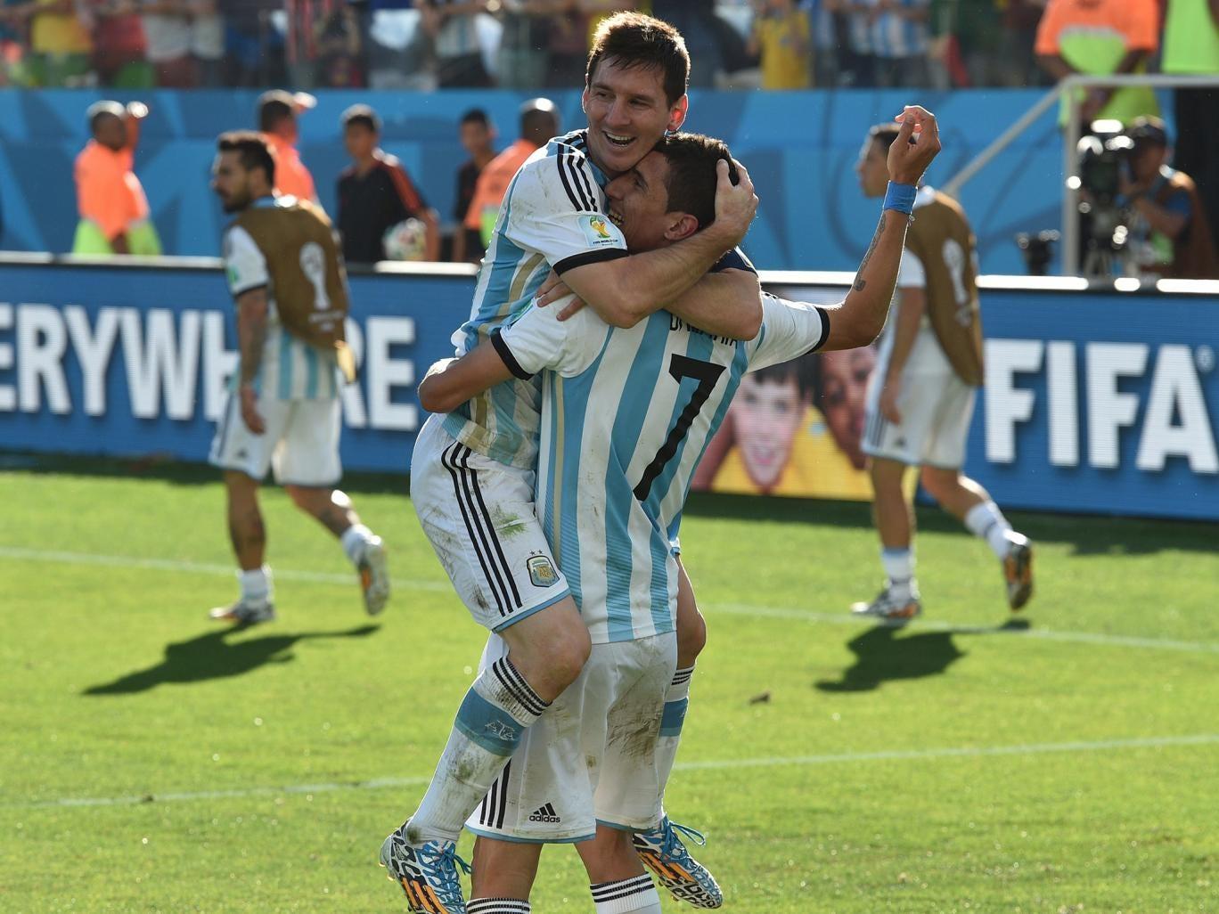 Angel di Maria celebrates his goal with Lionel Messi