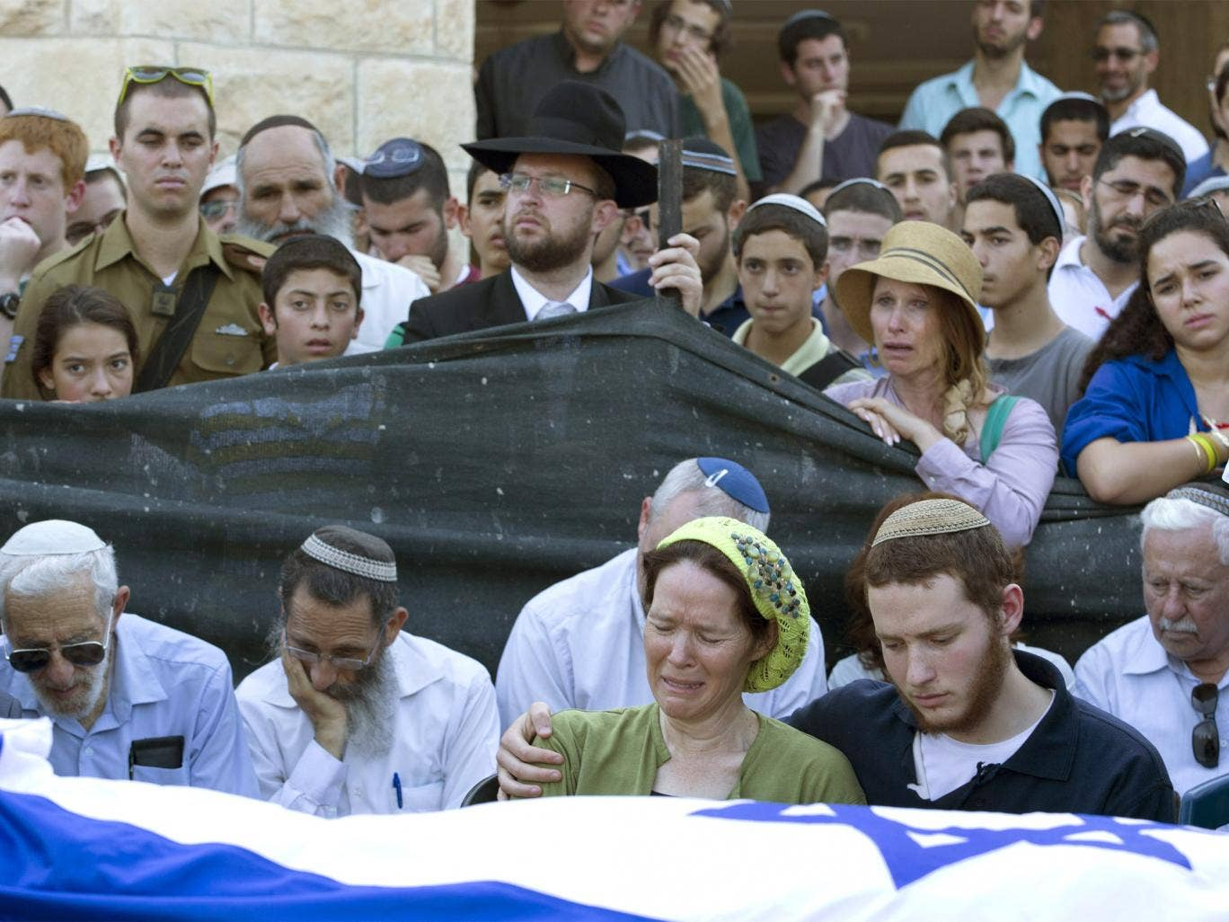 Avi and Rachel Fraenkel attend the funeral of their son, Naftali, a 16-year-old with dual Israeli-American citizenship, in their town of Nof Ayalon