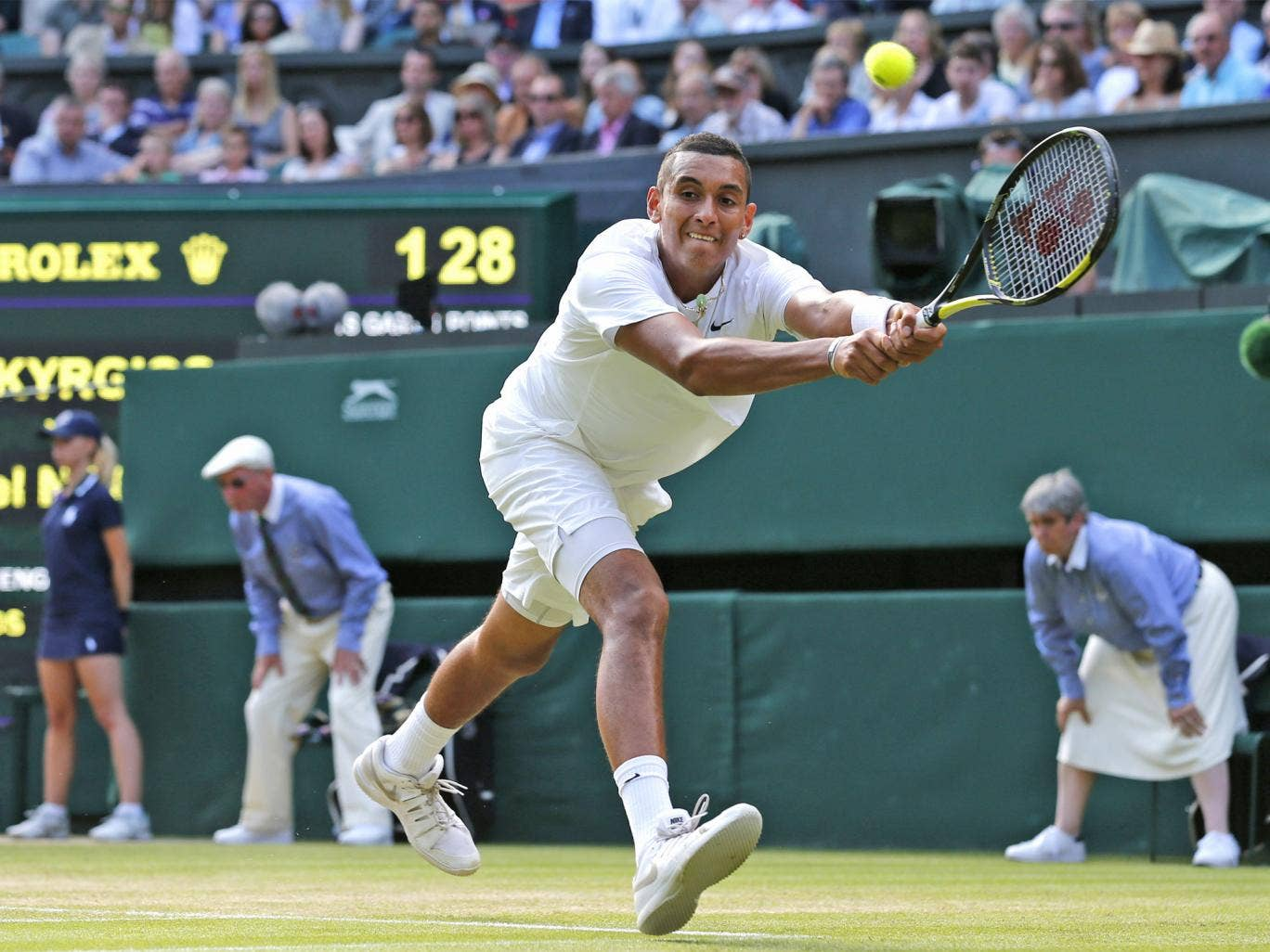 Nick Kyrgios stretches to play a return to Rafael Nadal in his remarkable upset victory