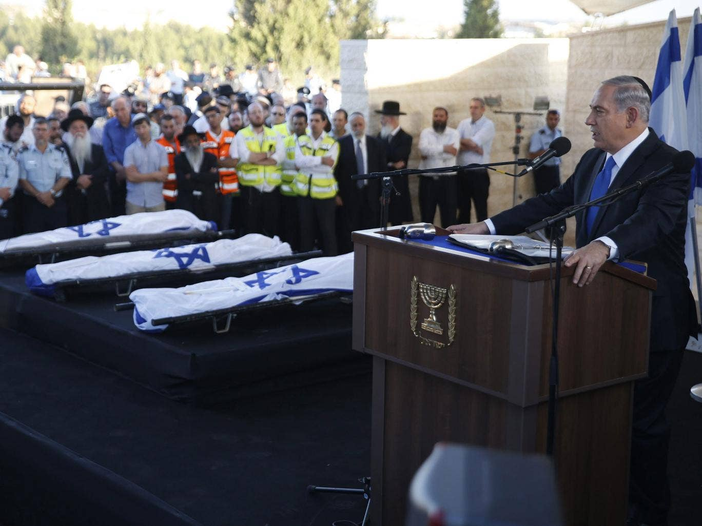 sraeli Prime Minister Benjamin Netanyahu (R) eulogizes three Israeli teens who were abducted and killed in the occupied West Bank, Gil-Ad Shaer, US-Israeli national Naftali Fraenkel, both 16, and Eyal Yifrah, 19, during their joint funeral in the Israeli