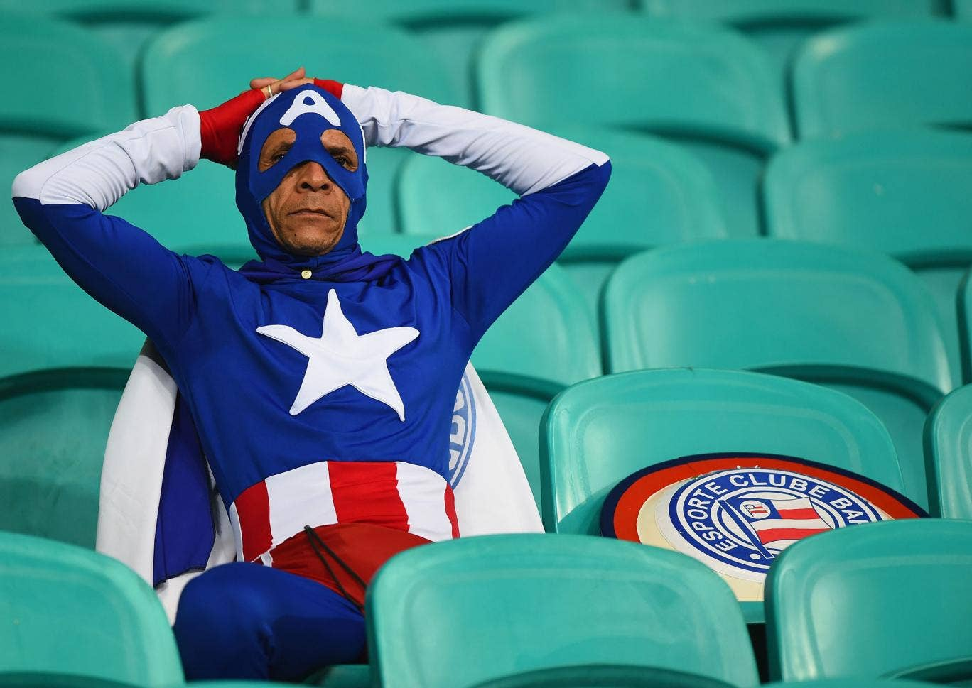 A fan dressed as Captain America looks on after Belgium's 2-1 victory in extra time during the 2014 FIFA World Cup Brazil