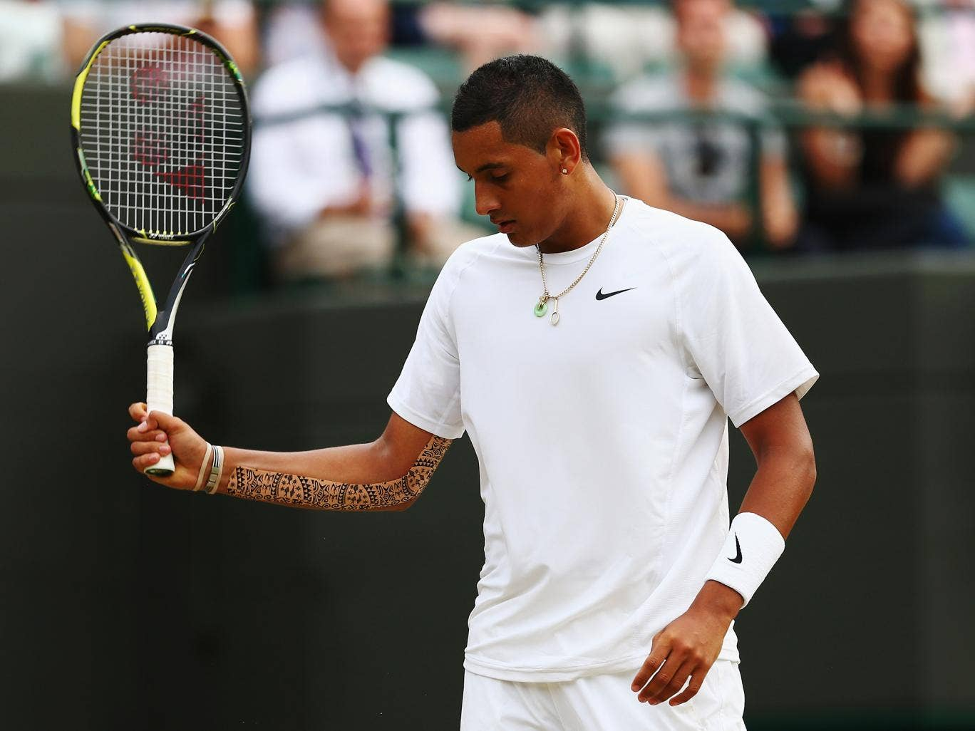 Nick Kyrgios shows his frustration during his Gentlemen's Singles quarter-final match defeat to Milos Raonic