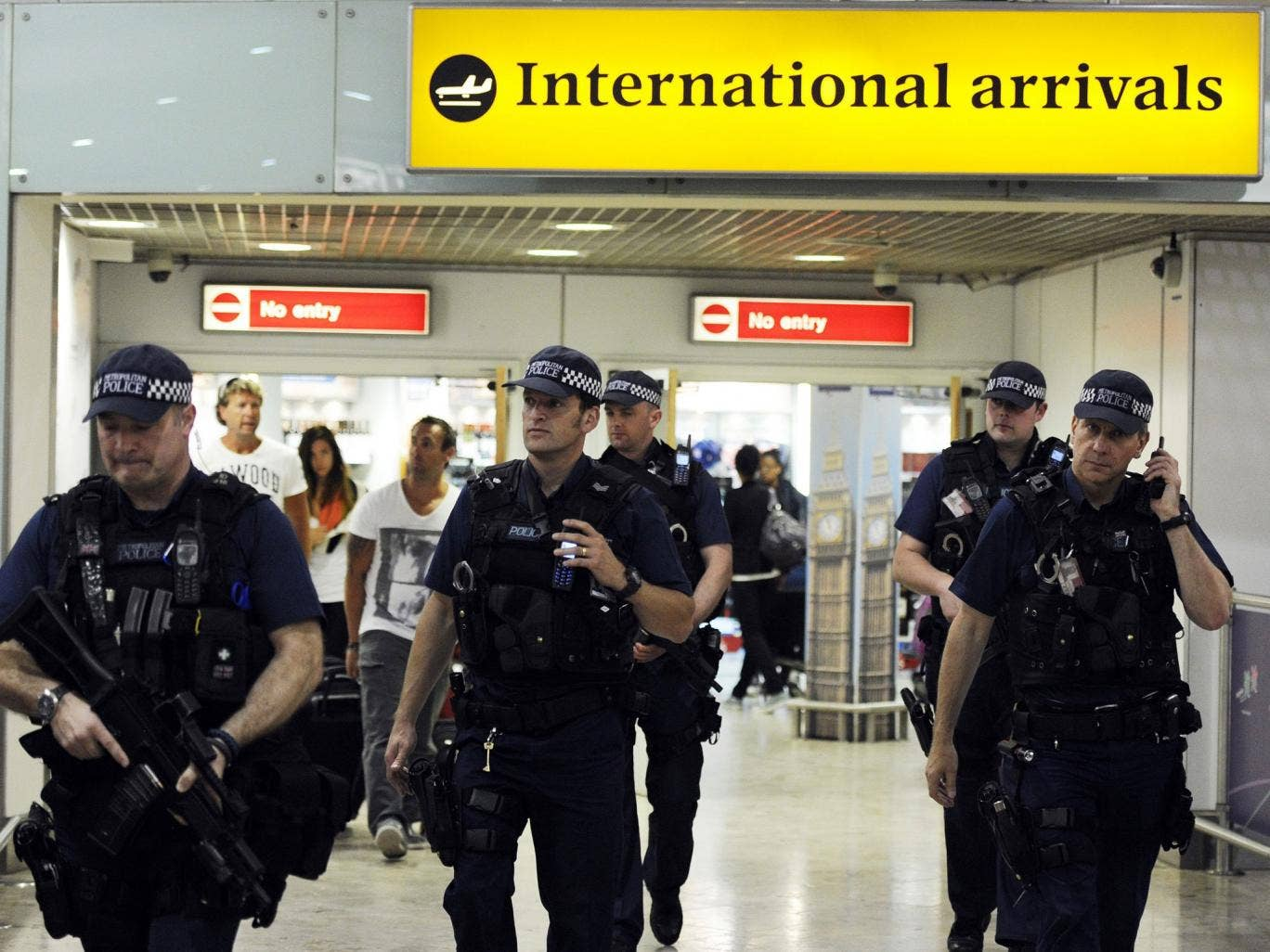 A file picture dated 23 July 2012 shows British police on patrol at Heathrow airport. US security officials are seeking to bolster security at airports abroad with flights to the United States amid new worries about potential bomb plots