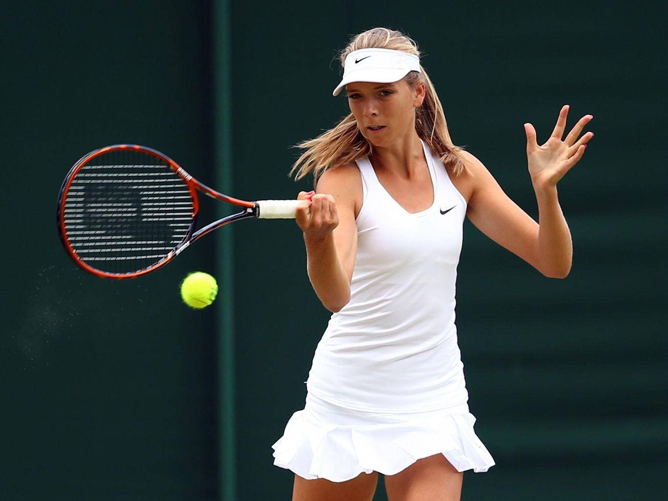 Katie Boulter of Great Britain during her Girls' Singles first round match against Priscilla Hon of Australia on day seven of Wimbledon