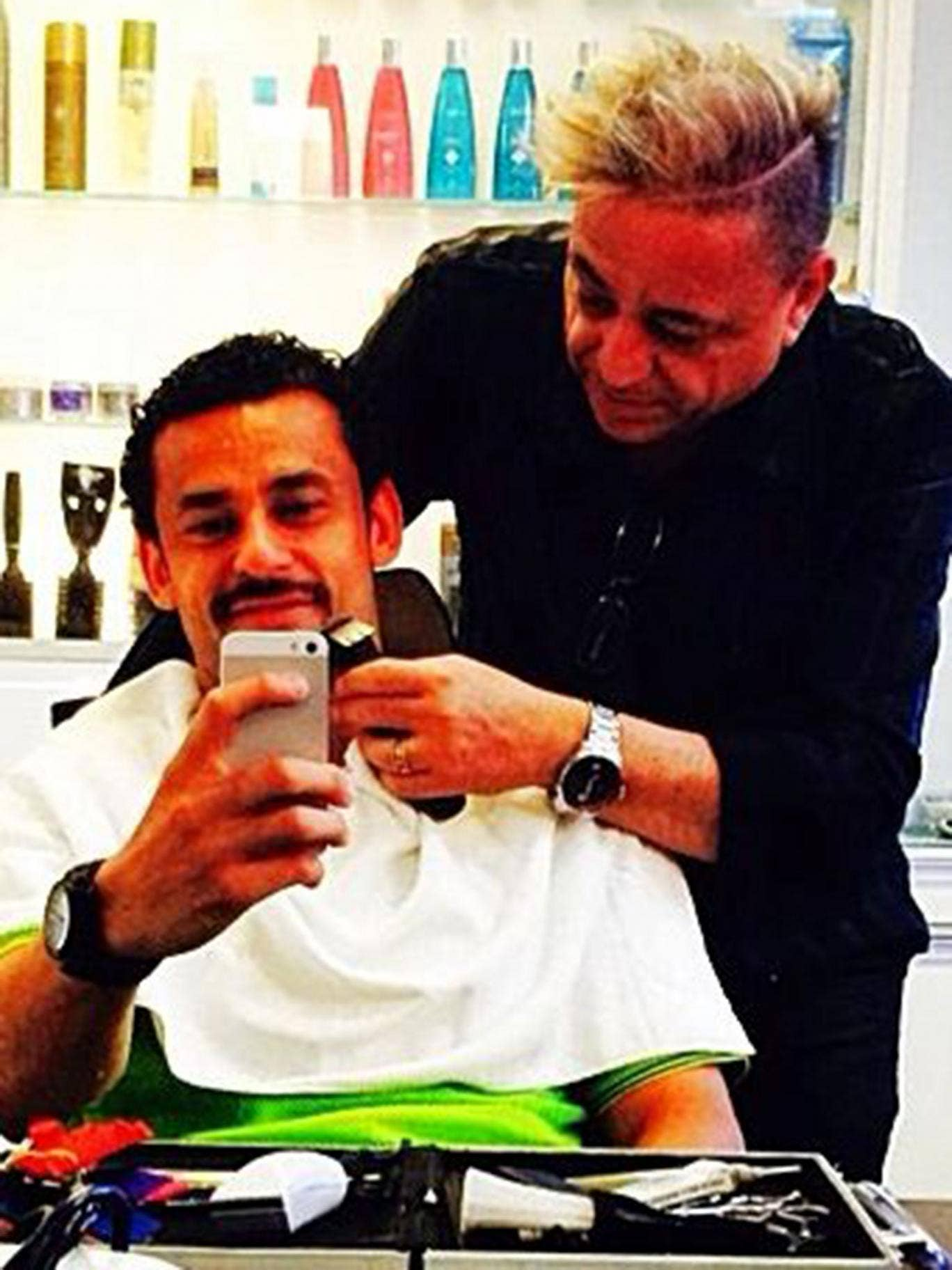 Fred getting his moustache at the barber shop