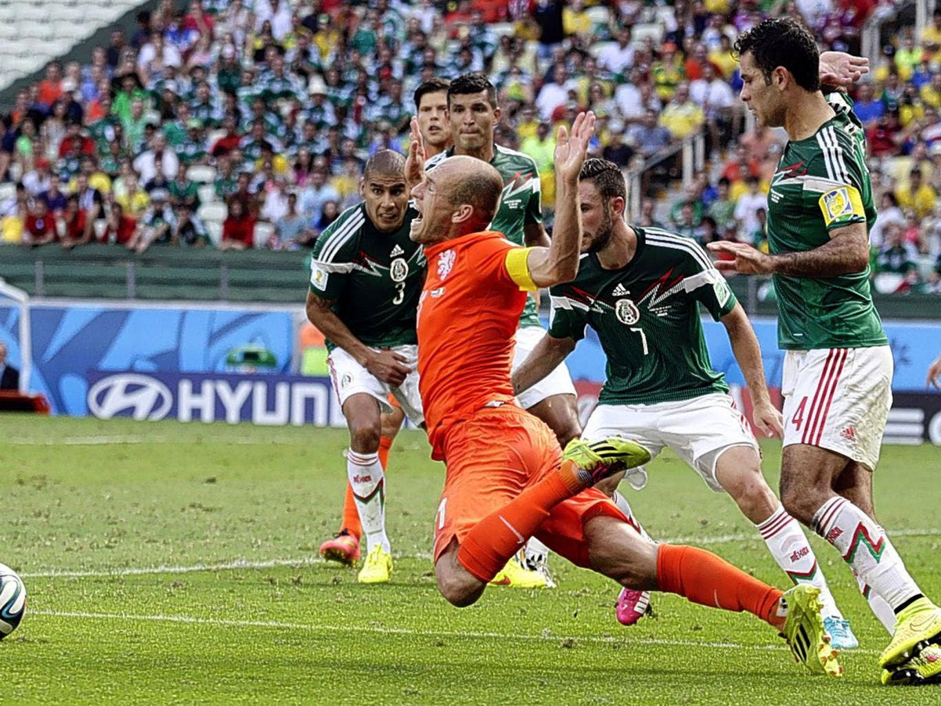 Arjen Robben goes down theatrically after being fouled by Mexico's Rafael Marquez, leading to the penalty that put Netherlands into the World Cup quarter-finals