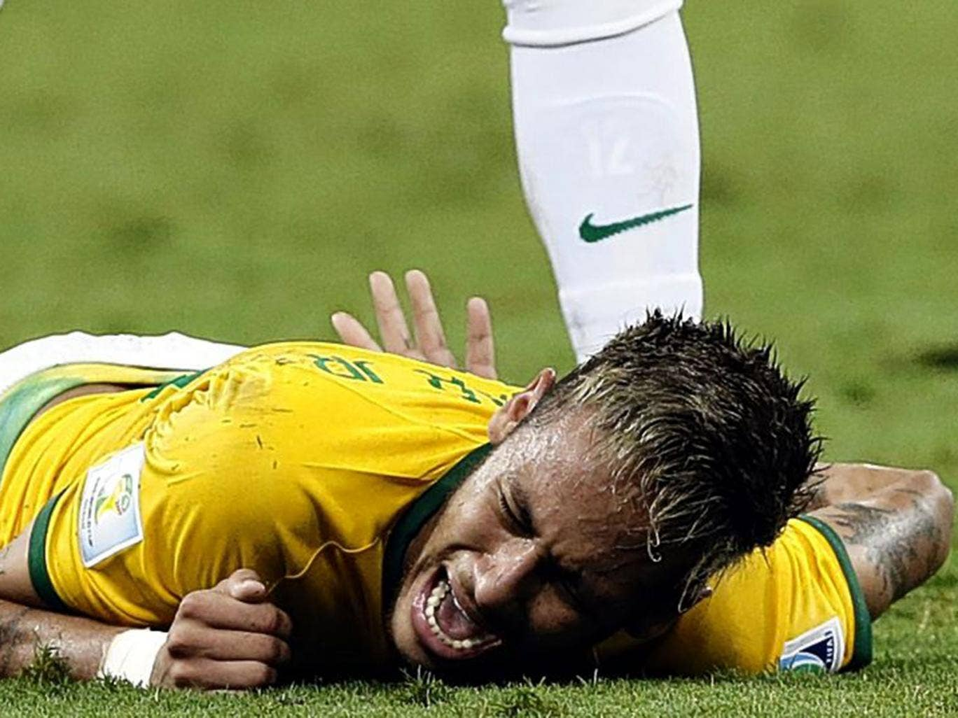 Agony: Neymar feels the pain of the challenge that put him out of the World Cup