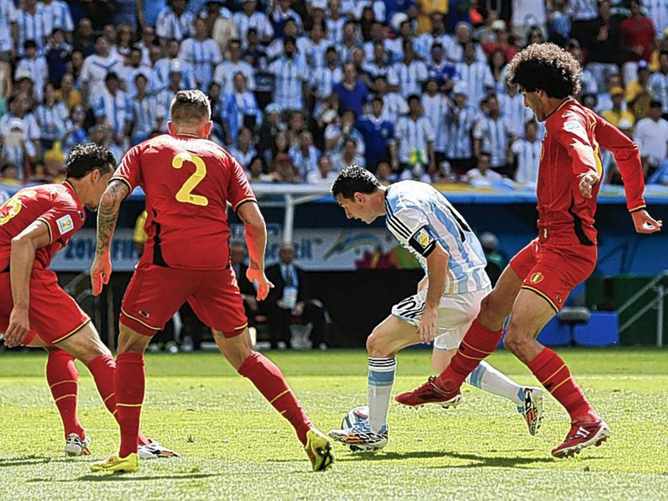 Little master: Lionel Messi (centre) tries to escape the attention of Marouane Fellaini and three other Belgian players