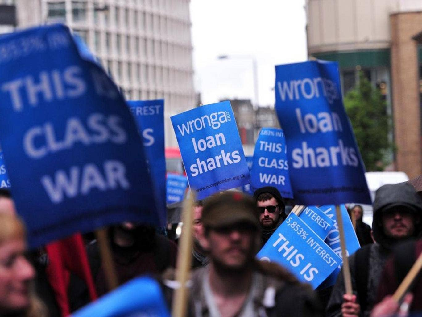 Protesters rally against Britain's biggest payday lender