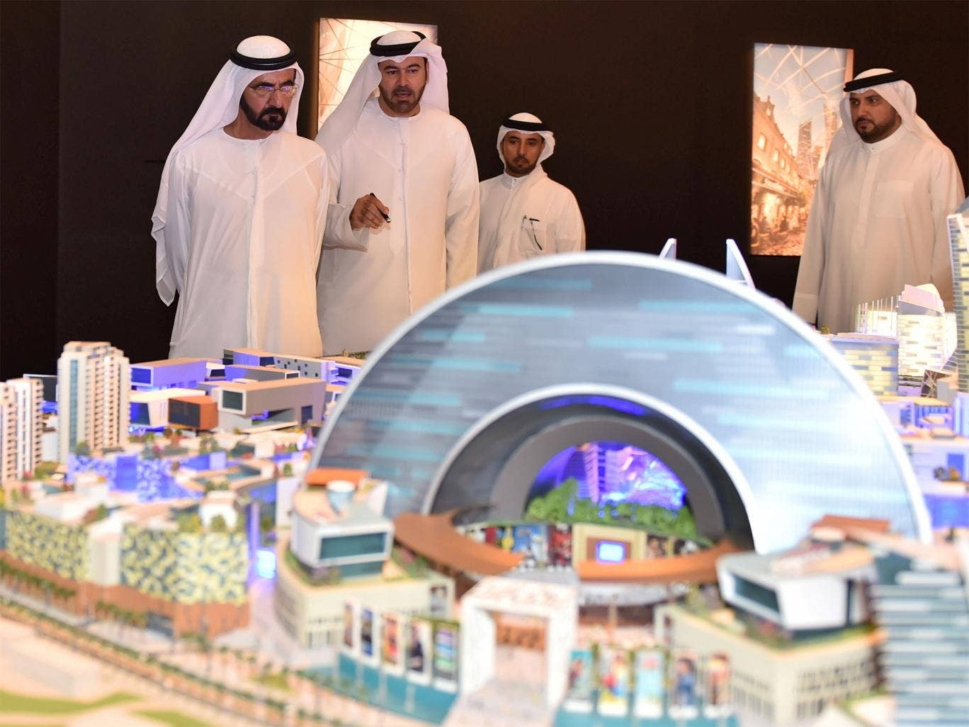 Sheikh Mohammed Bin Rashid al-Maktoum (left), ruler of Dubai, looking at a model of the 'Mall of the World' project during its presentation in Dubai