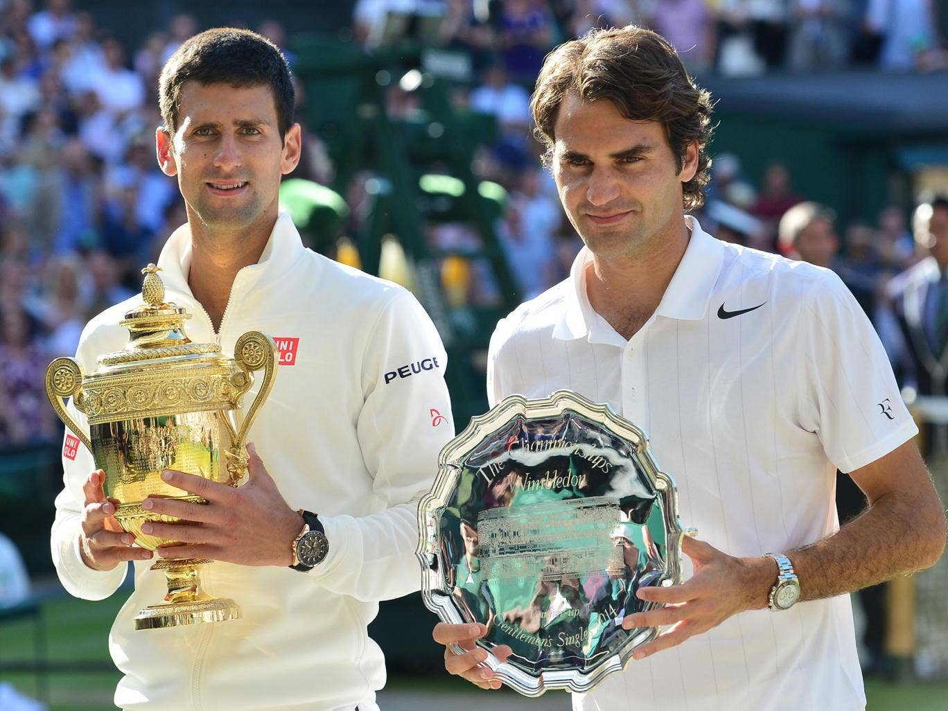 Novak Djokovic and Roger Federer pose with their trophies after the final