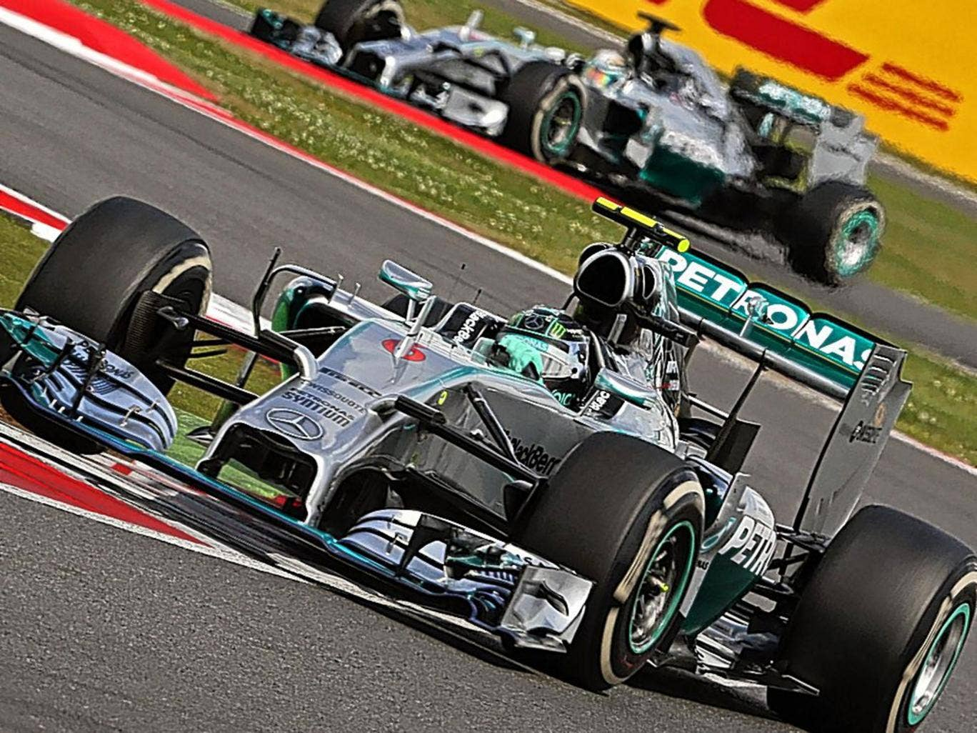 Nico Rosberg drives ahead of Lewis Hamilton at Sunday's British Grand Prix. The head-to-head between the Mercedes team-mates has delivered at times breathless racing