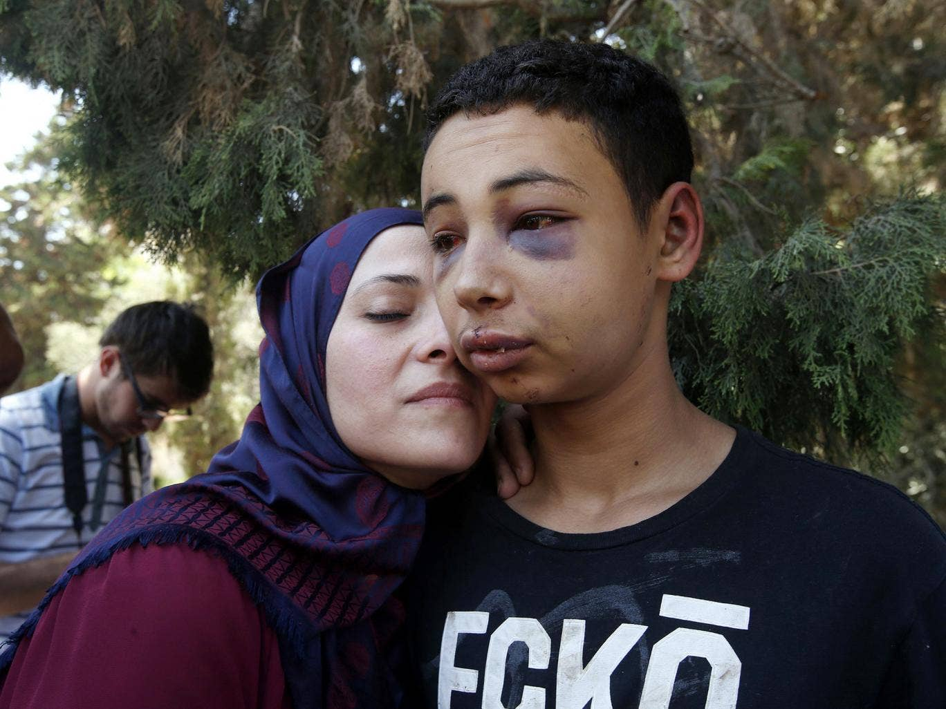 Tariq Khdeir is greeted by his mother after being released from jail in Jerusalem. An Israeli judge released from jail and placed under house arrest the 15-year-old American of Palestinian descent whose apparent beating by Israeli police in East Jerusalem