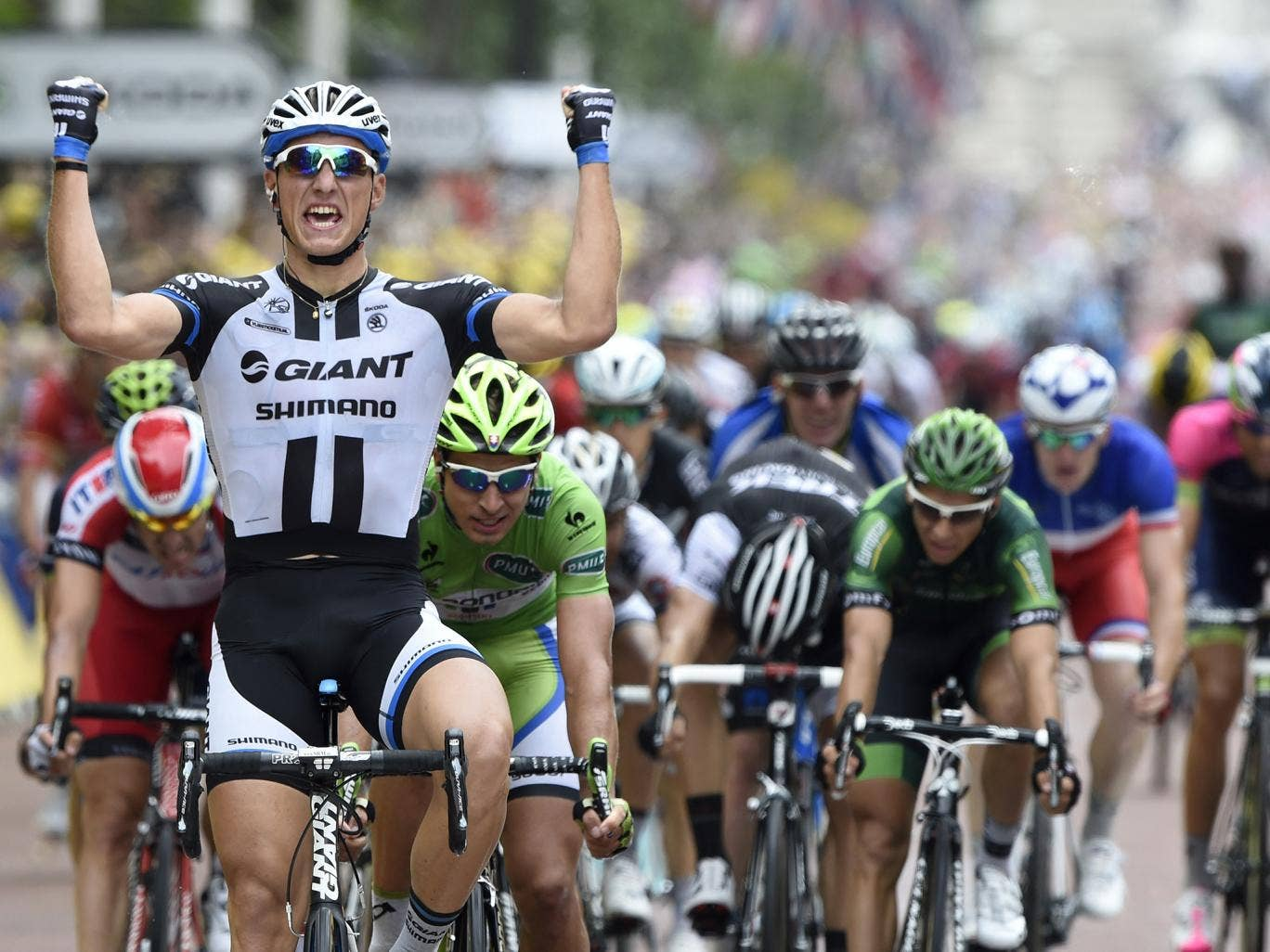 Germany's Marcel Kittel celebrates as he crosses the finish line at the end of the 155 km third stage of the 101st edition of the Tour de France
