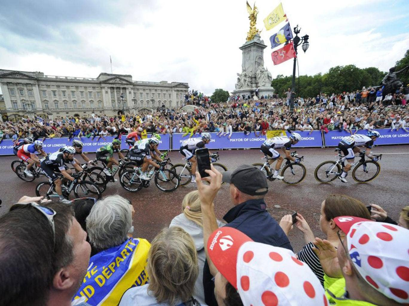 Record crowds line the route as Britain's final stage of this year's  Tour de France is met with carnival atmosphere in London (EPA)