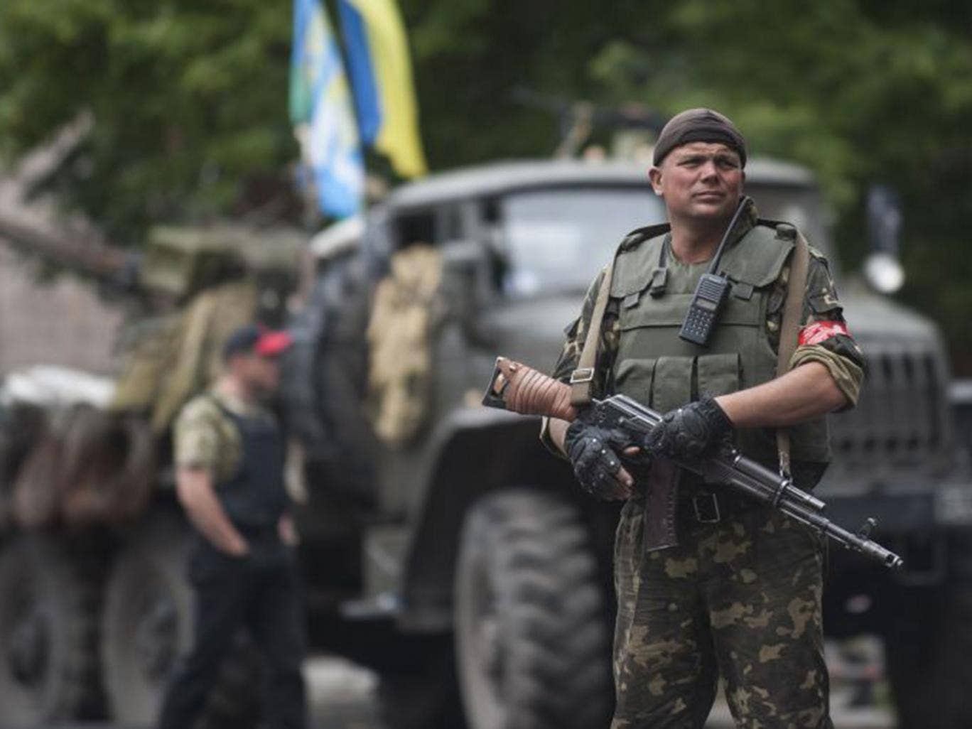 A Ukrainian soldier guards a security building in Slovyansk. On Saturday Ukrainian troops  forced the rebels out of the city which had until then been the centre of the fighting