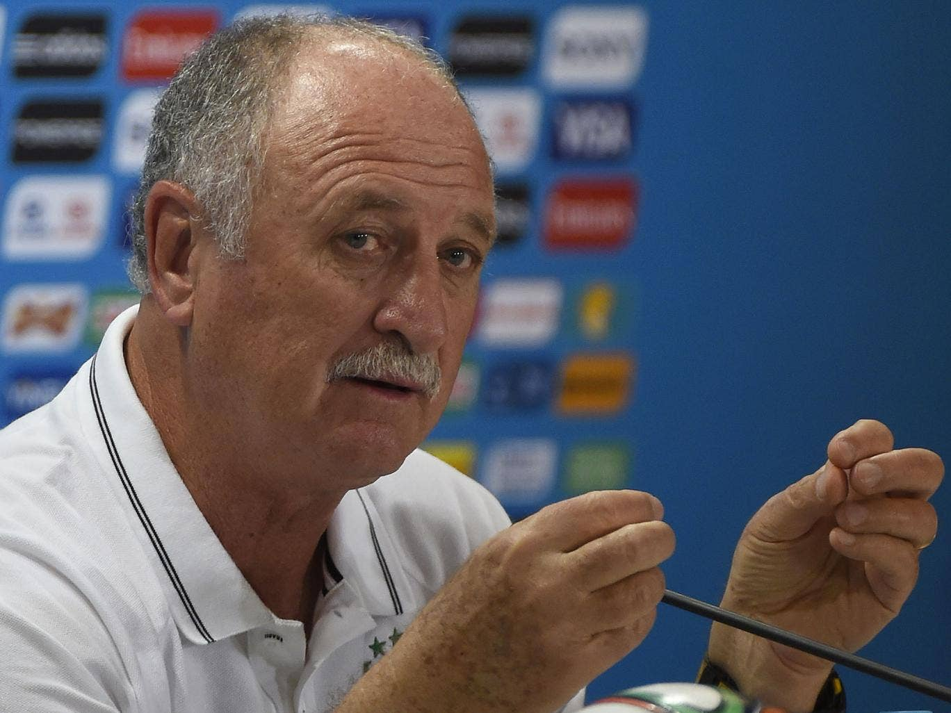 Brazil manager Luis Felipe Scolari does his best attempt to practice lifting the World Cup trophy
