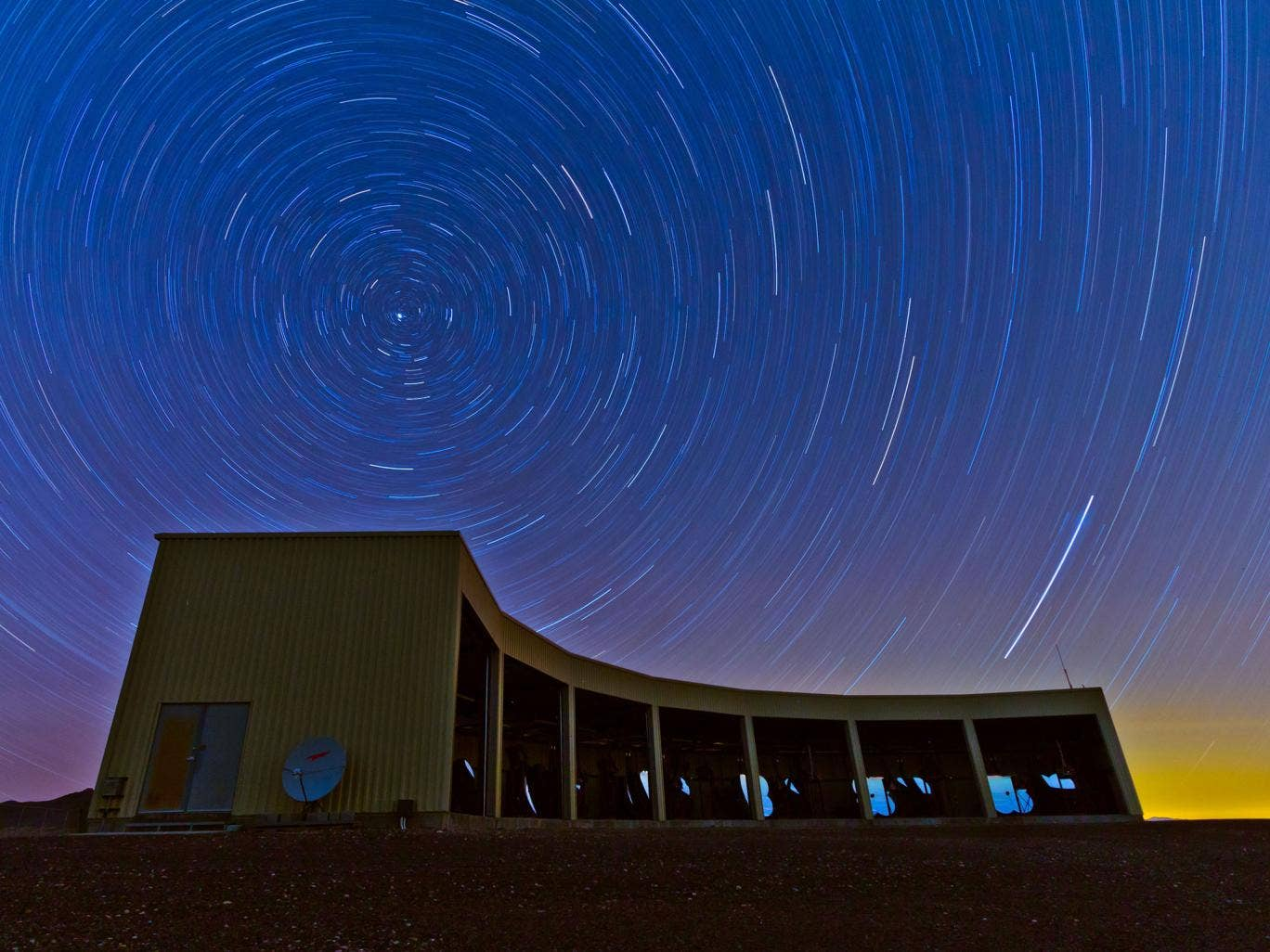 A time-lapse photo of the Middle Drum facility of the Telescope Array, a $25 million cosmic ray observatory that sprawls across the desert west of Delta, Utah.