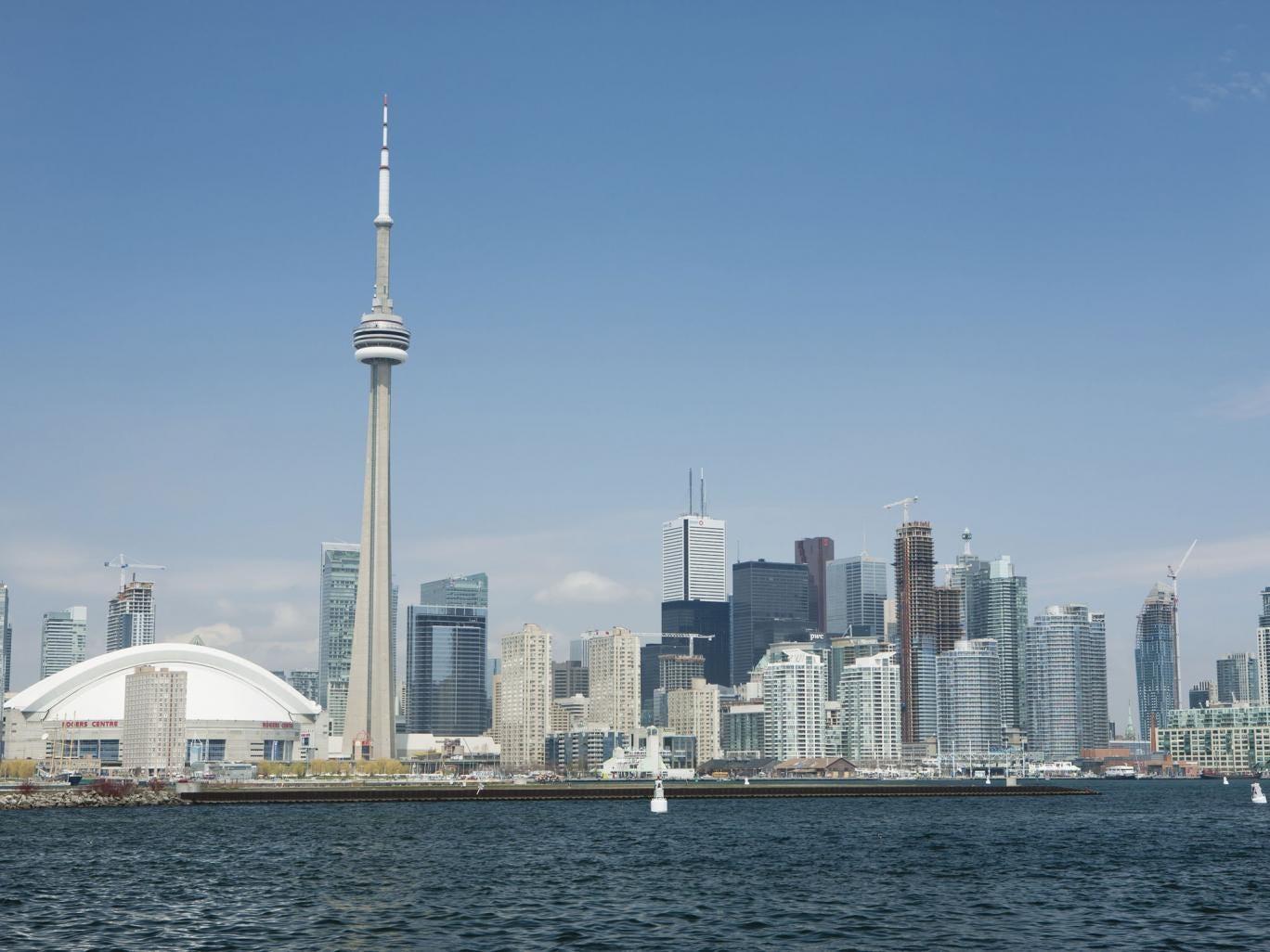Toronto Skyline From Lake Ontario With Blue Sky And Clouds Toronto, Ontario, Canada 2013