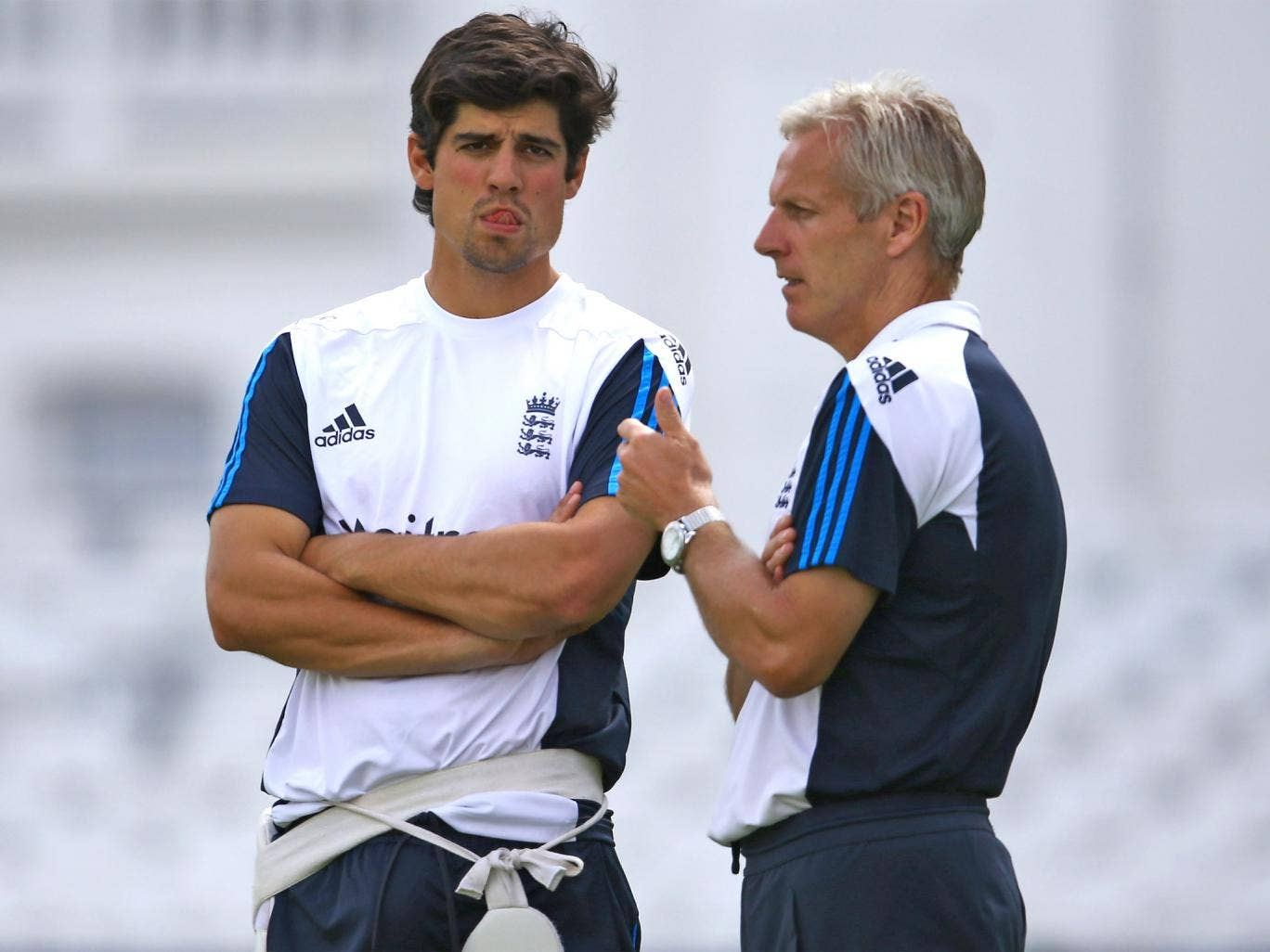England captain Alastair Cook talks to coach Peter Moores