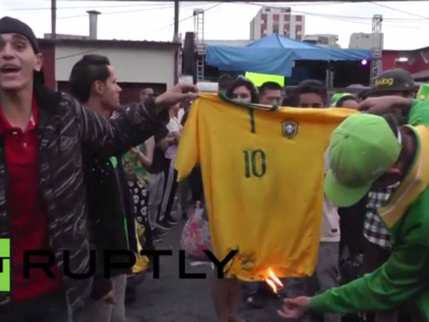 Fans burn a Neymar shirt on the streets of Brazil following the 7-1 defeat to Germany