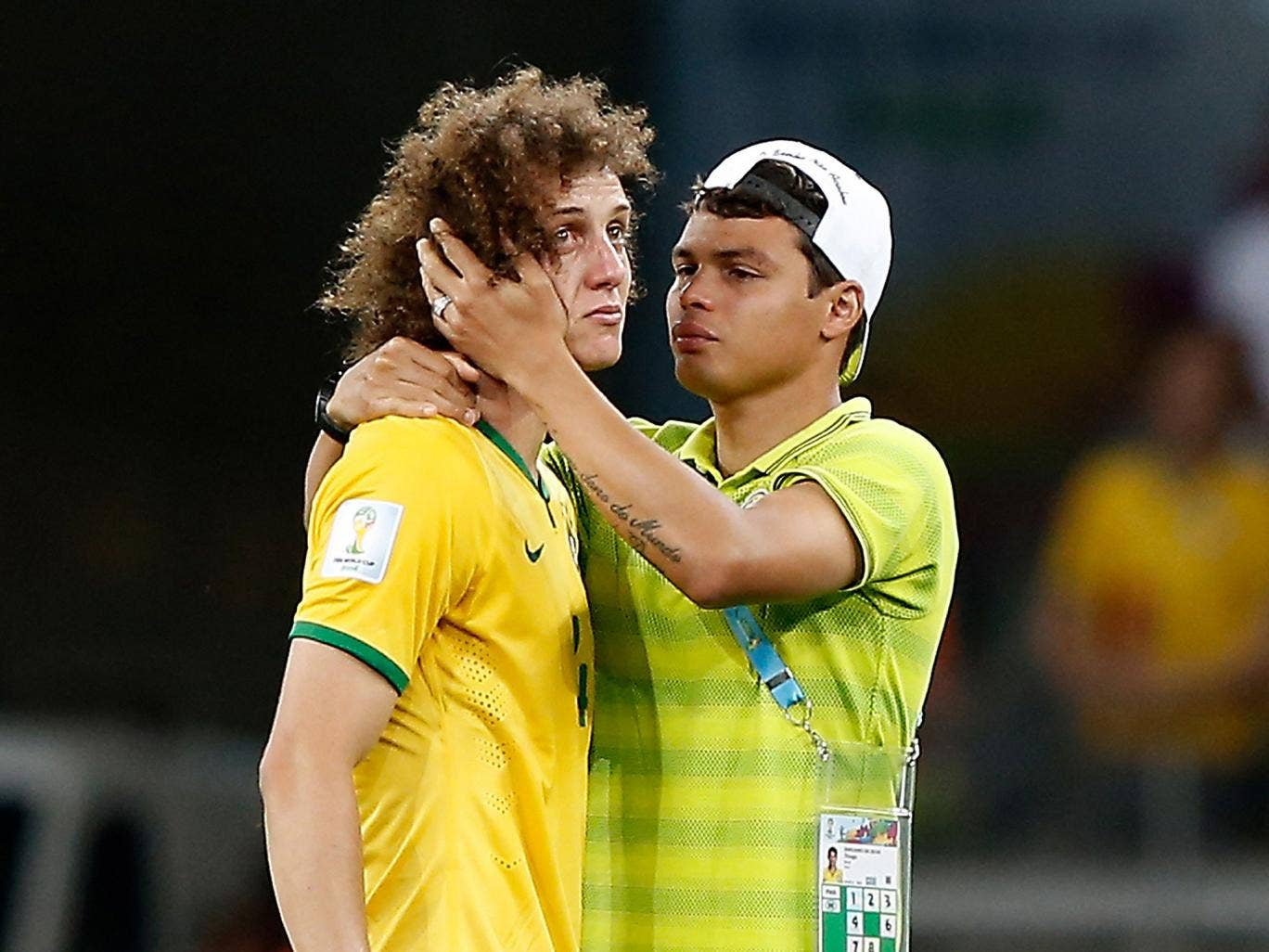 David Luiz is consoled by Thiago Silva after the 7-1 defeat at the hands of Germany