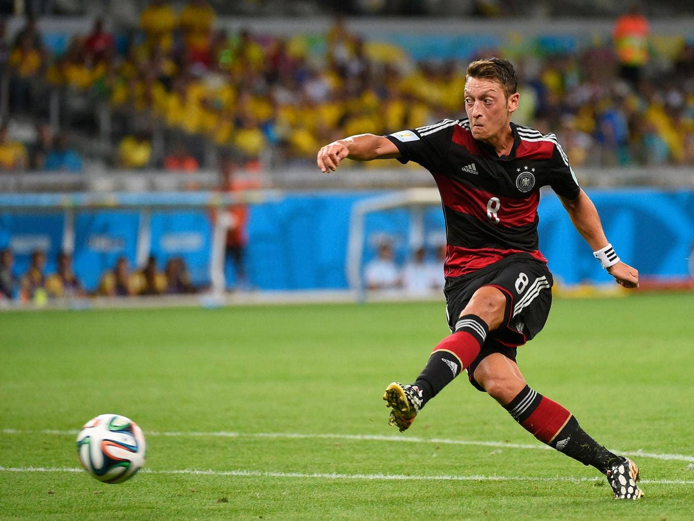Mesut Ozil has an effort on goal, which drifts agonisingly wide of the post