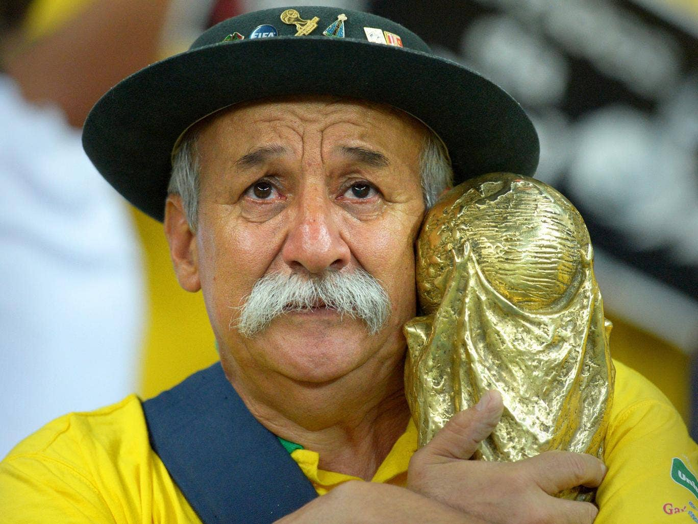 A Brazilian fan shows his dejection after the FIFA World Cup 2014 semi final match between Brazil and Germany at the Estadio Mineirao in Belo Horizonte, Brazil