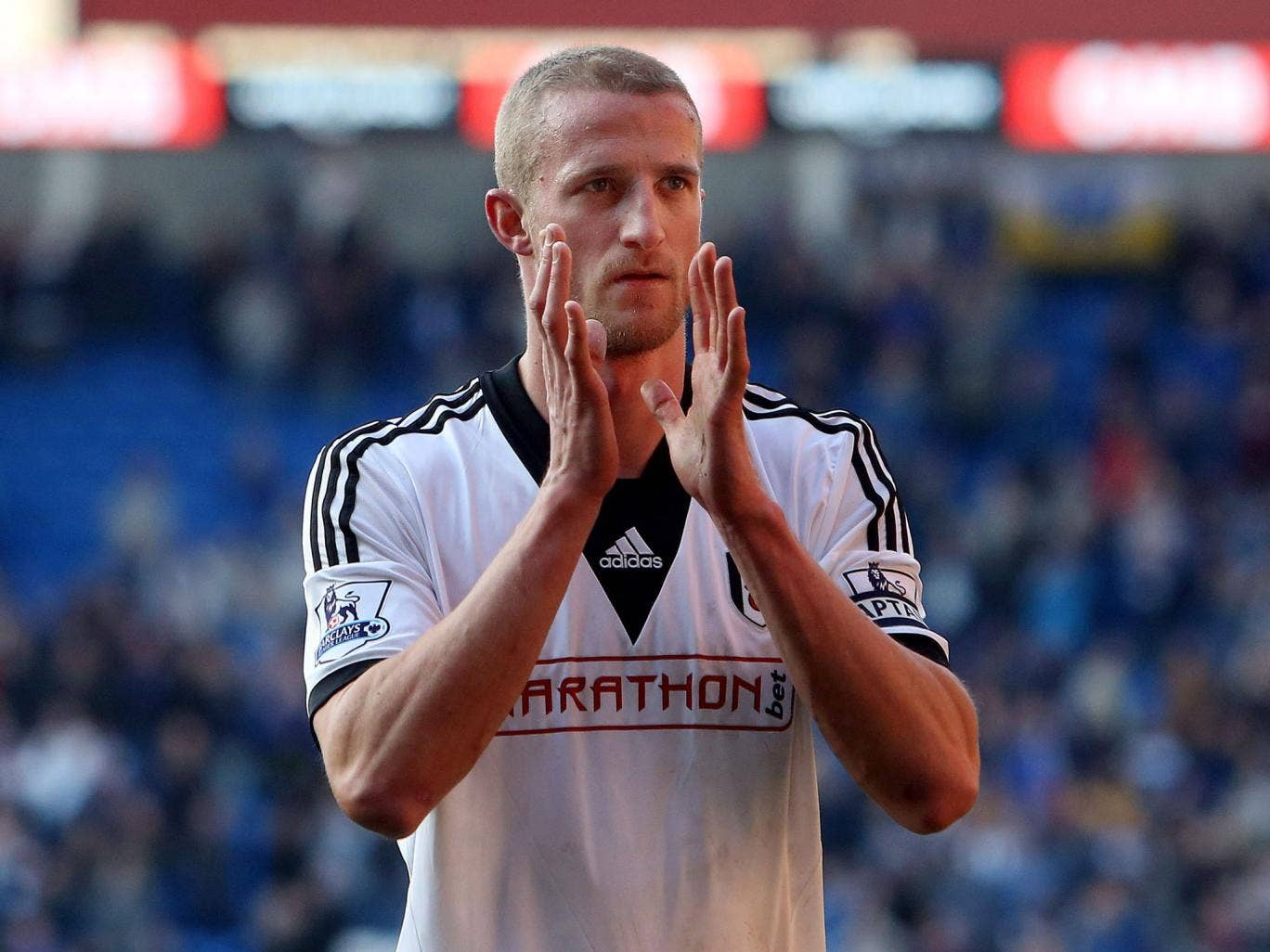 Brede Hangeland applauds supporters following the final whistle