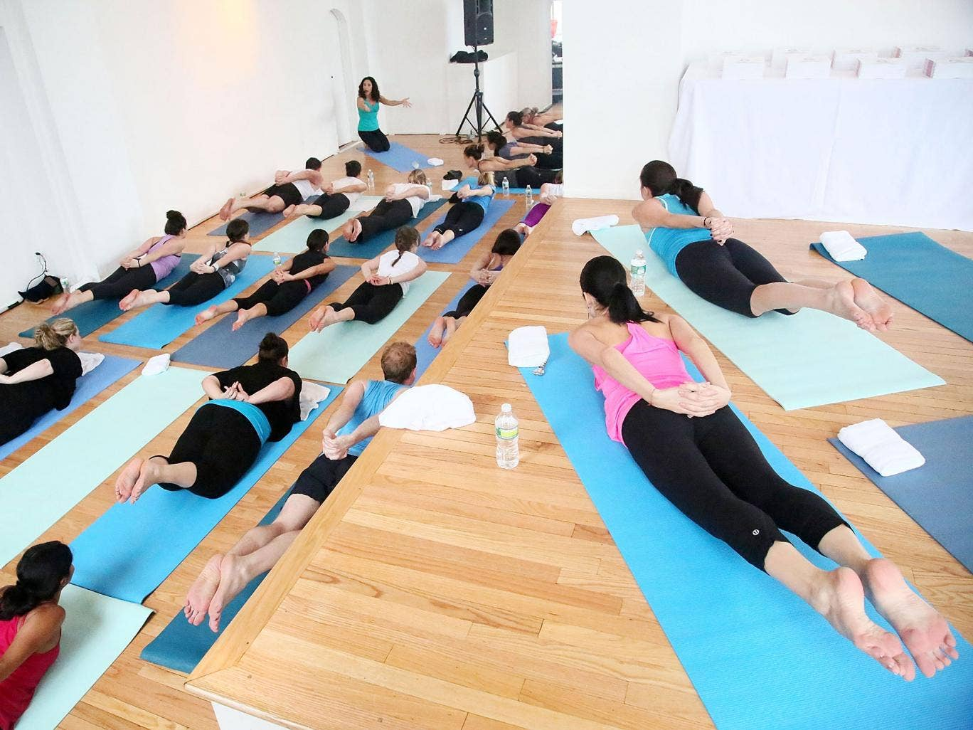 Glamour magazine hosts a yoga class with Yogalosophy author Mandy Ingber on June 10, 2013 in New York City.