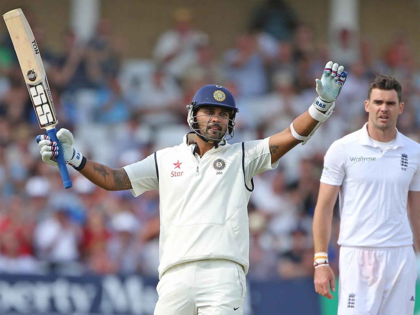 Murali Vijay raises his bat after reaching his century at Trent Bridge