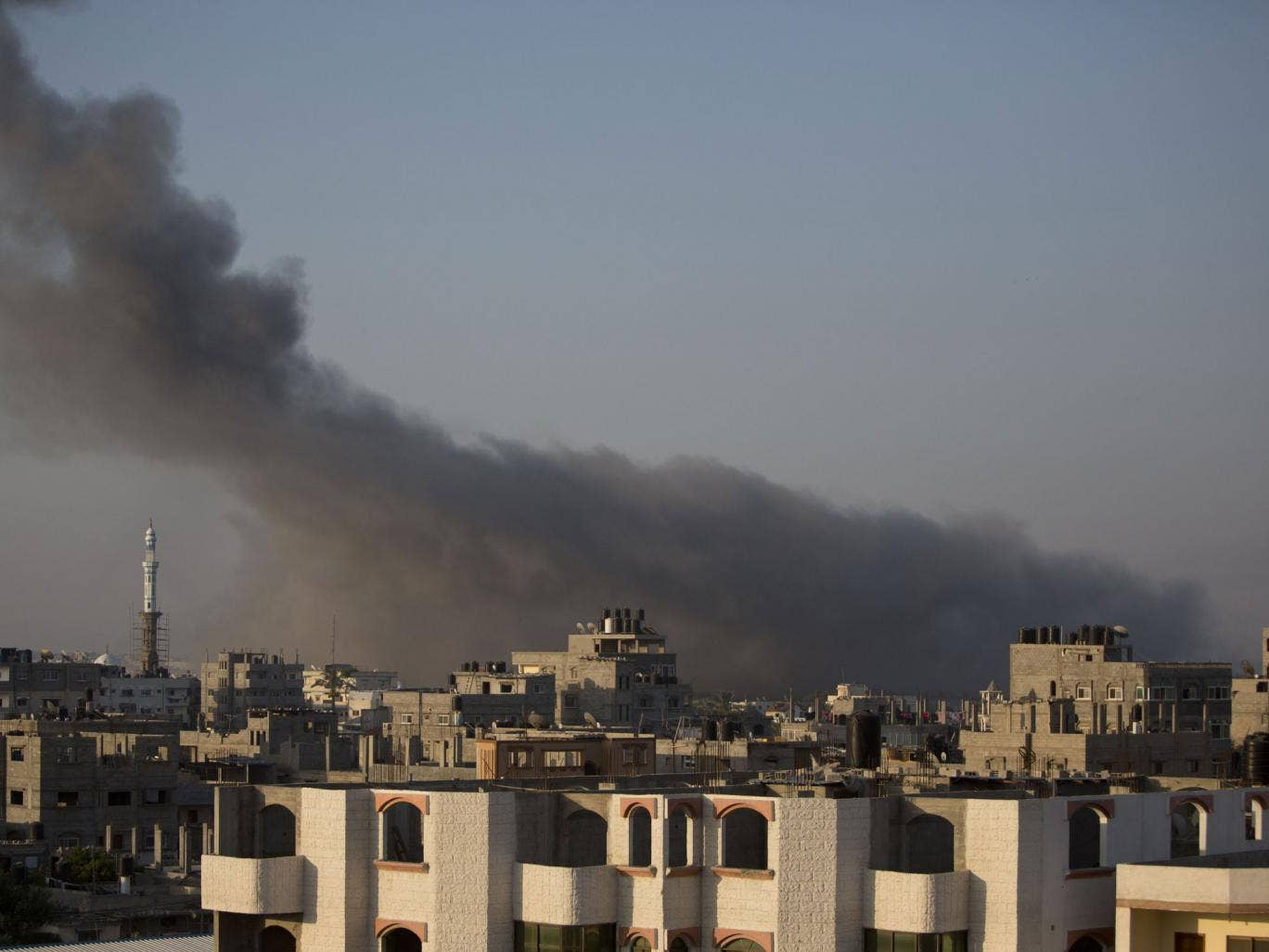 Smoke billows from buildings following an Israeli air strike in Gaza on July 10, 2014