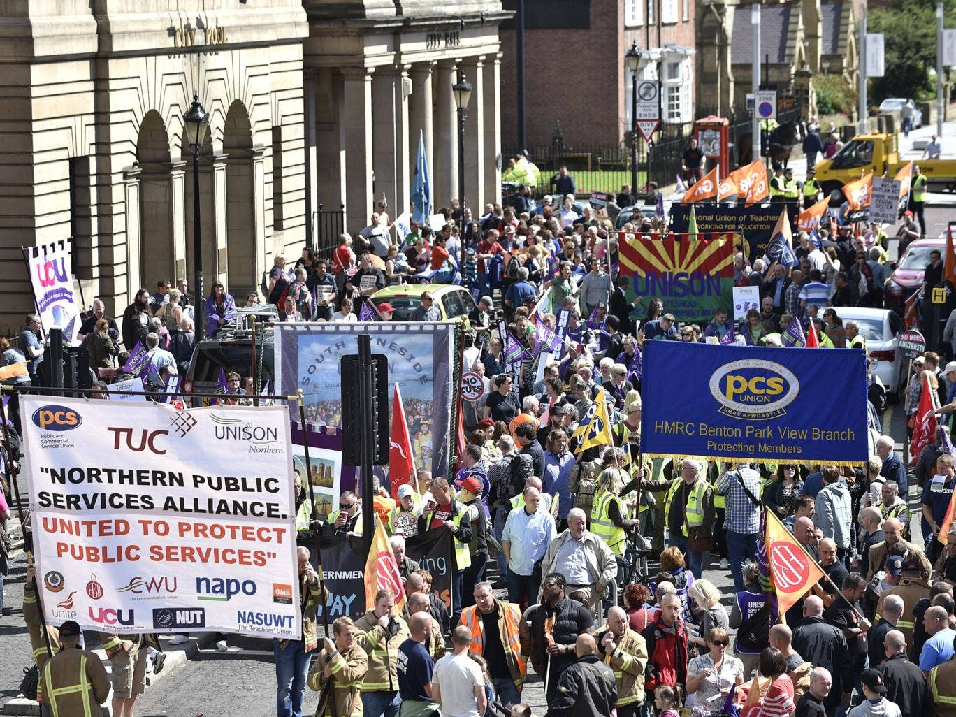 Public sector workers march through Newcastle city centre as they take part in the one-day walkout as part of bitter disputes over pay, pensions, jobs and spending cuts