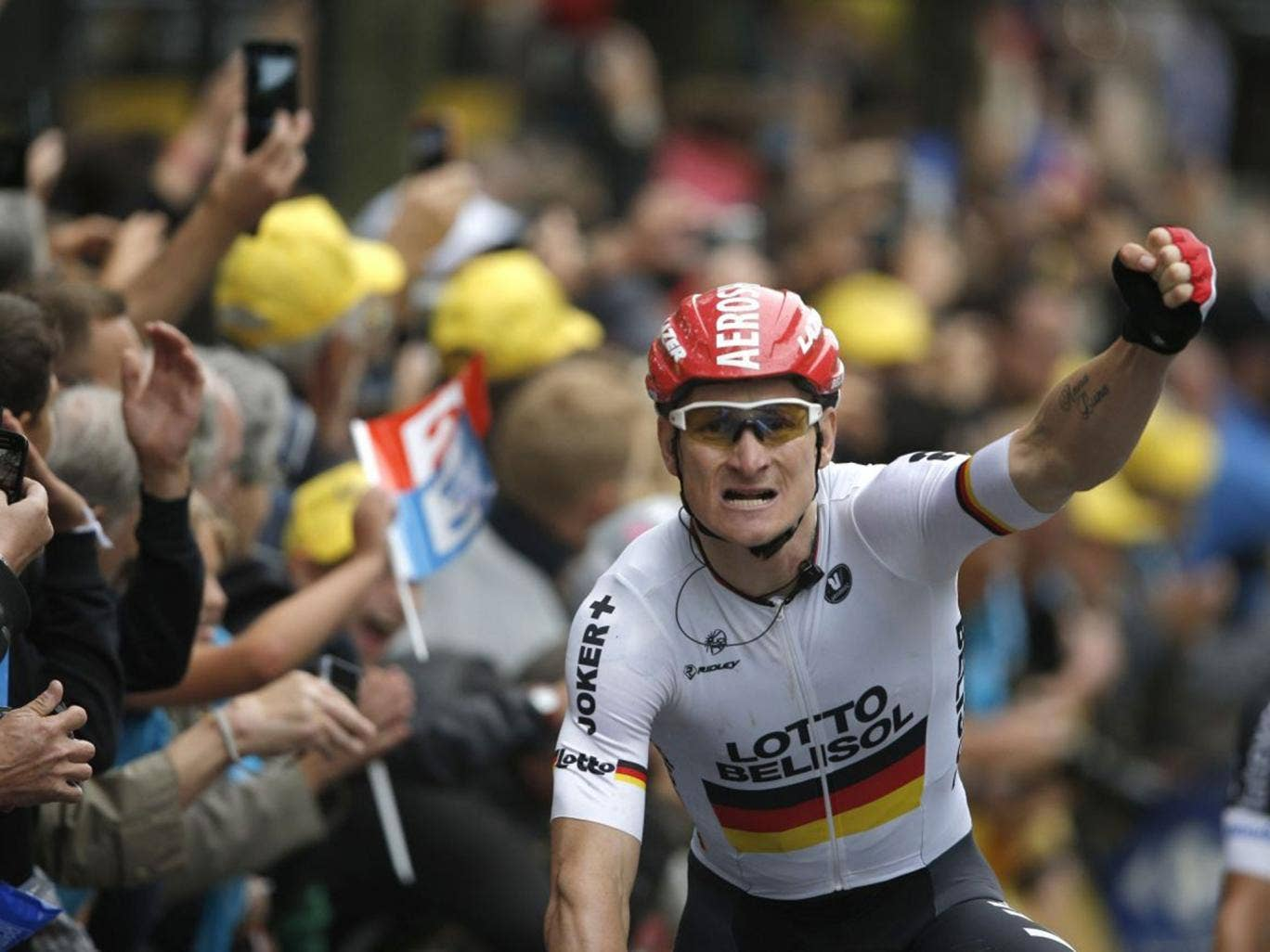 Germany's Andre Greipel crosses the finish line to win the sixth stage of the Tour de France cycling race over 194 kilometers (120.5 miles) with start in Arras and finish in Reims, France