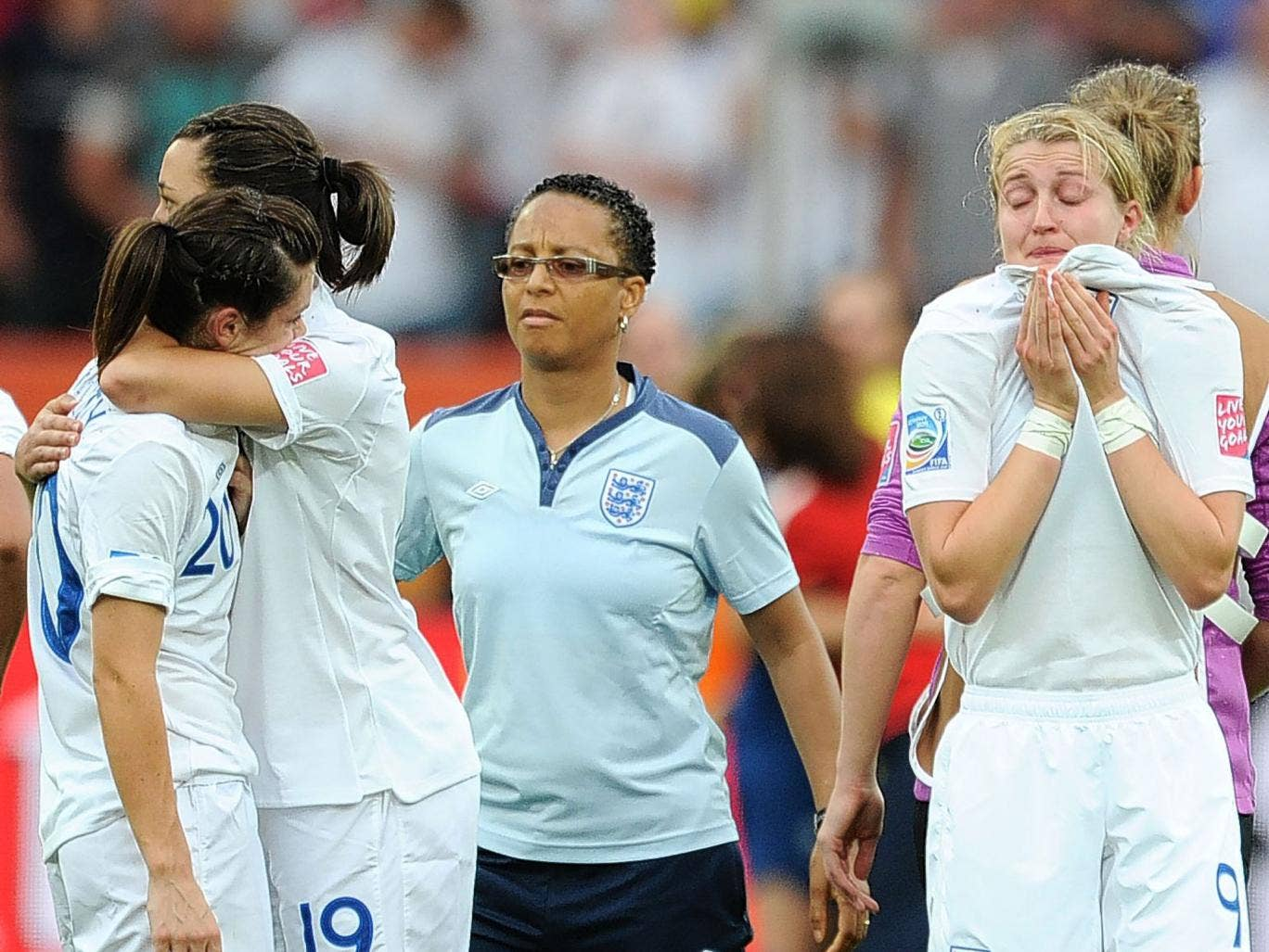 Dejection for Hope Powell (centre) and the England players after their penalty shoot-out defeat to France at the 2011 Women's World Cup