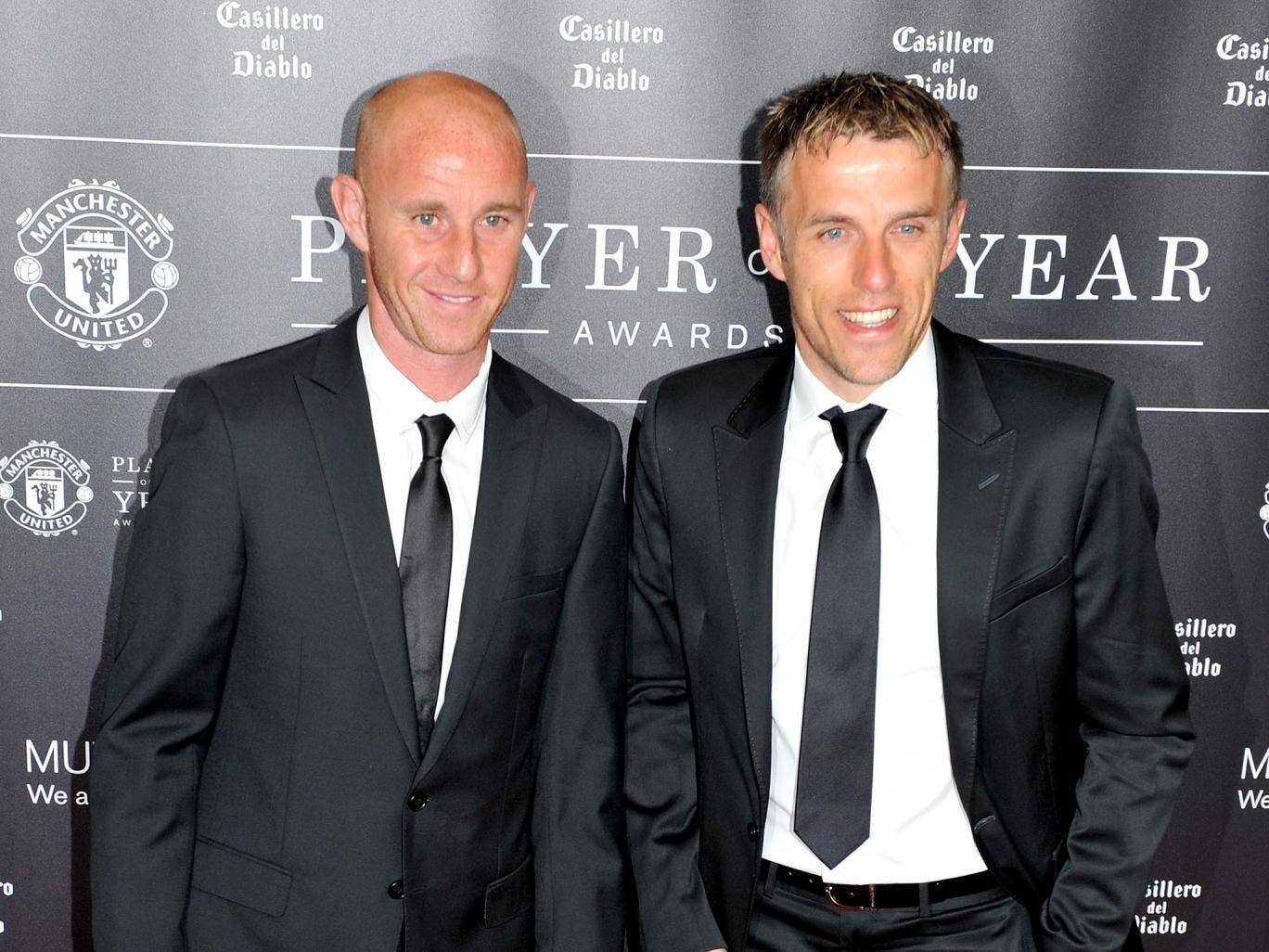 Nicky Butt and Phil Neville attend the Manchester United Player of the Year awards